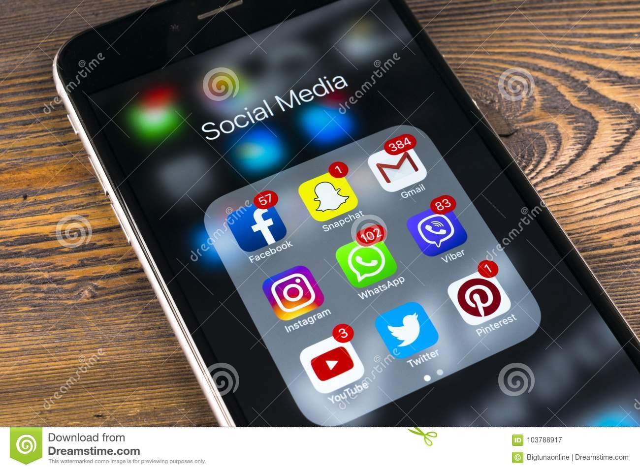 Apple IPhone 7 On Wooden Table With Icons Of Social Media Facebook