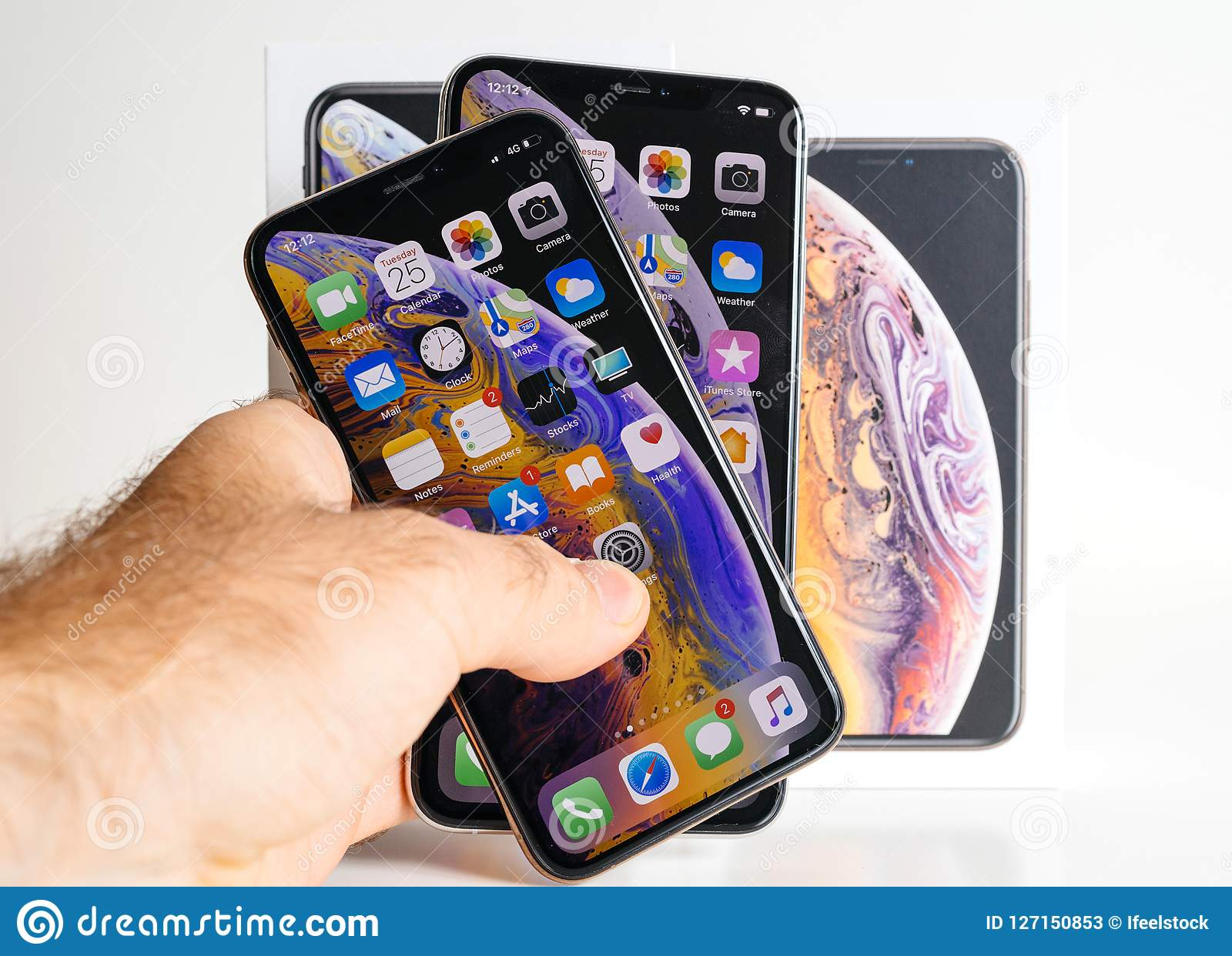 Apple IPhone Xs Max Gold Silver Smartphone In Man`s Hand
