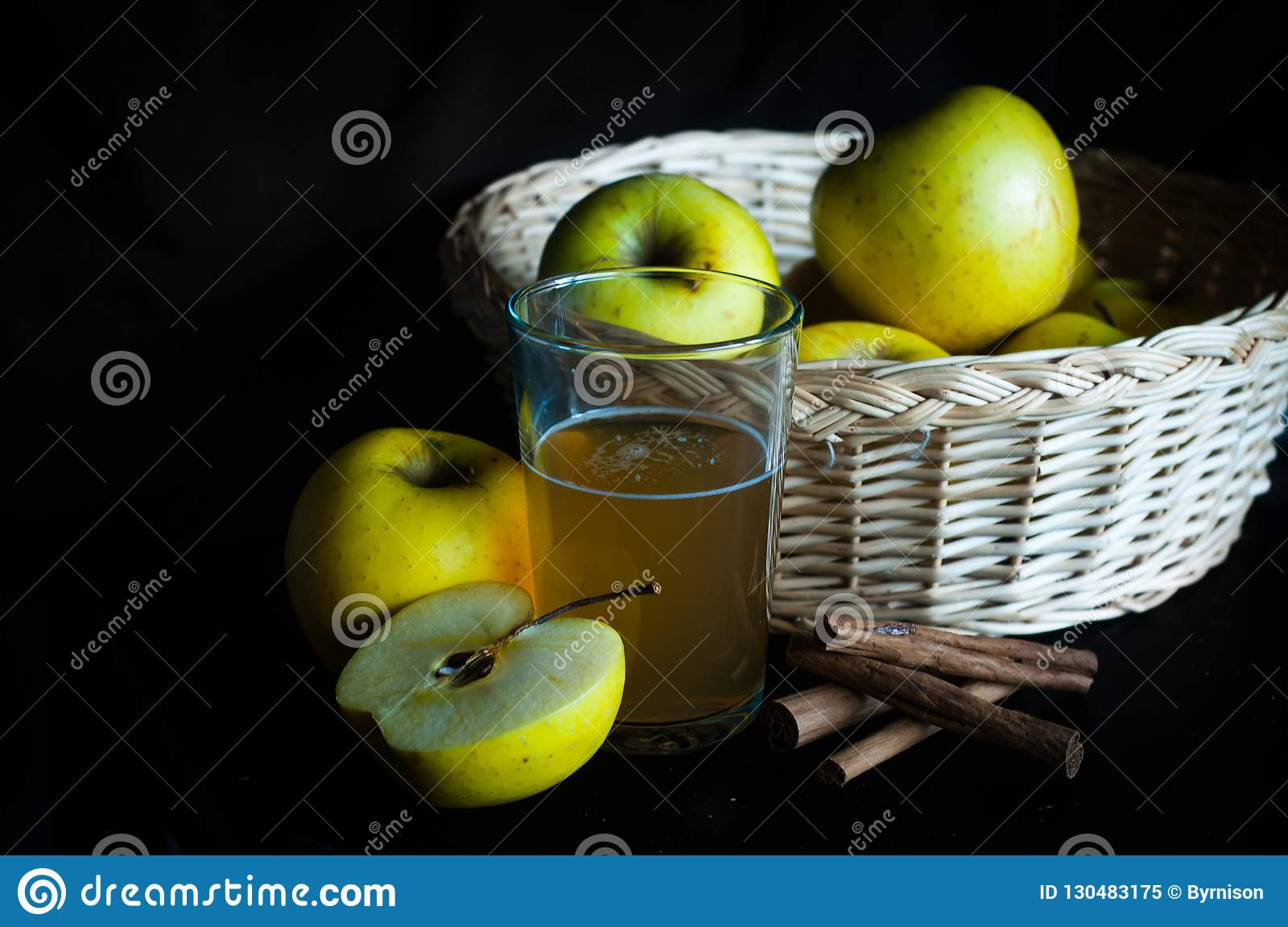 Apple juice in glass with apples