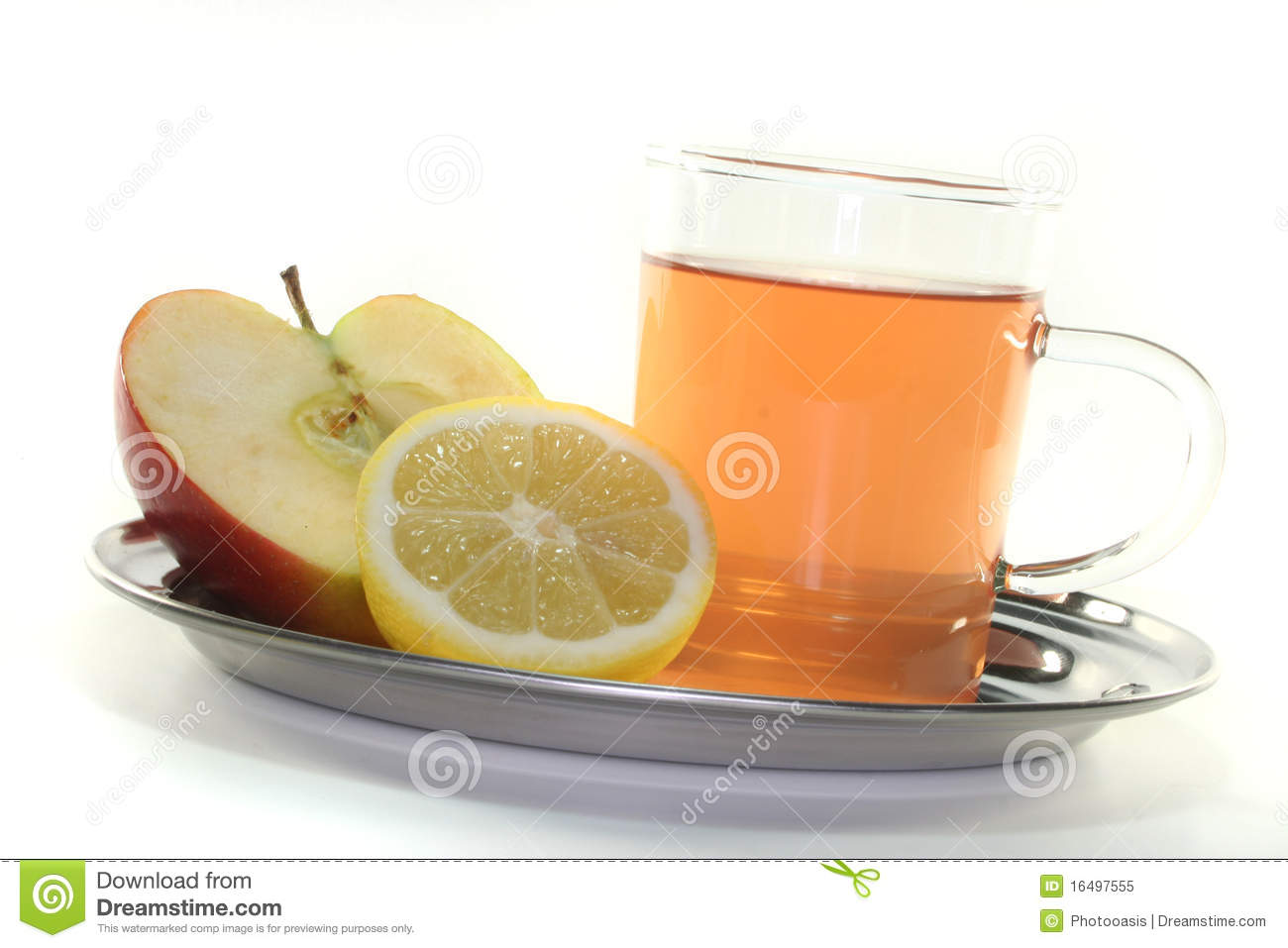 glass of apple-lemon tea with fresh apple and lemon.