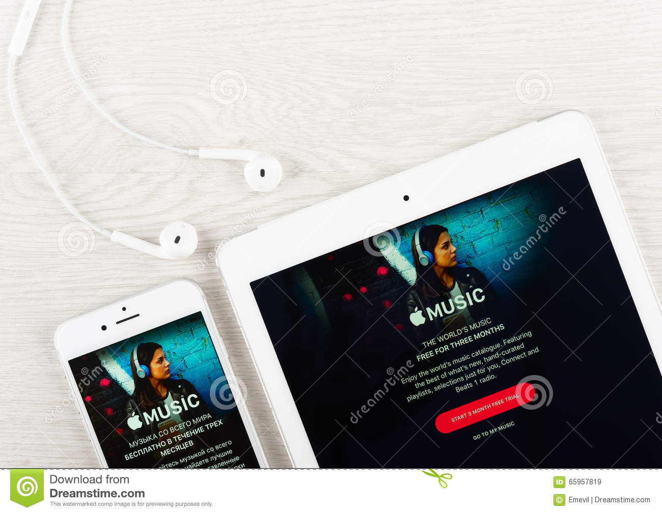 Apple Music Application On The Display Of Iphone And Ipad Editorial