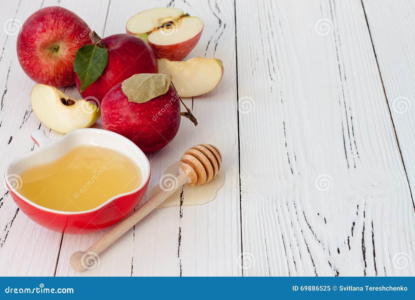 Apple och honung, traditionell mat av det judiska nya året - Rosh Hashana Copyspace bakgrund