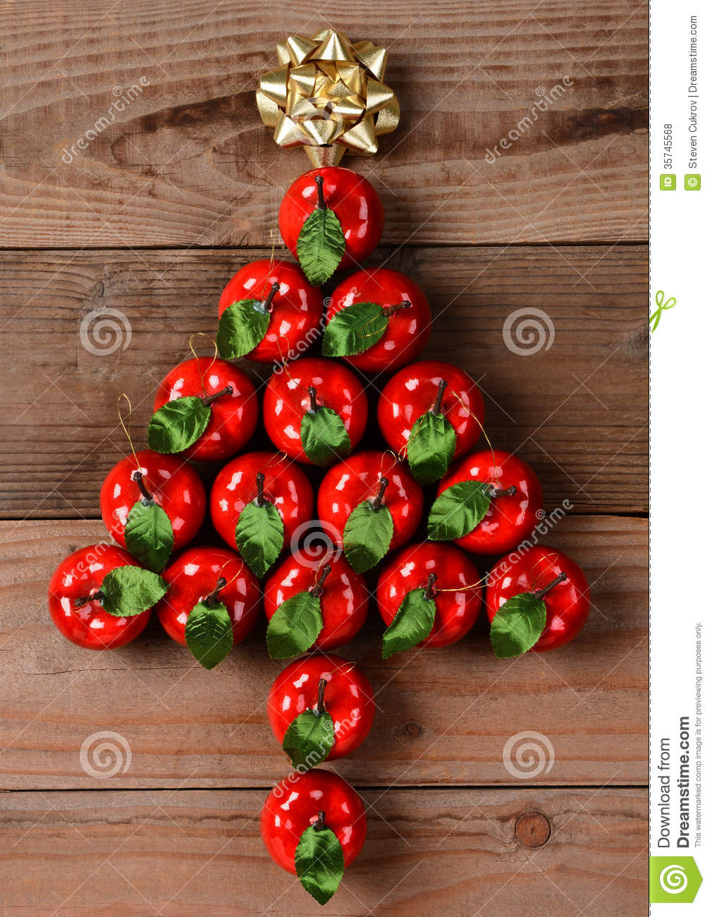 Apple ornaments in christmas tree shape stock photo for Apple tree decoration