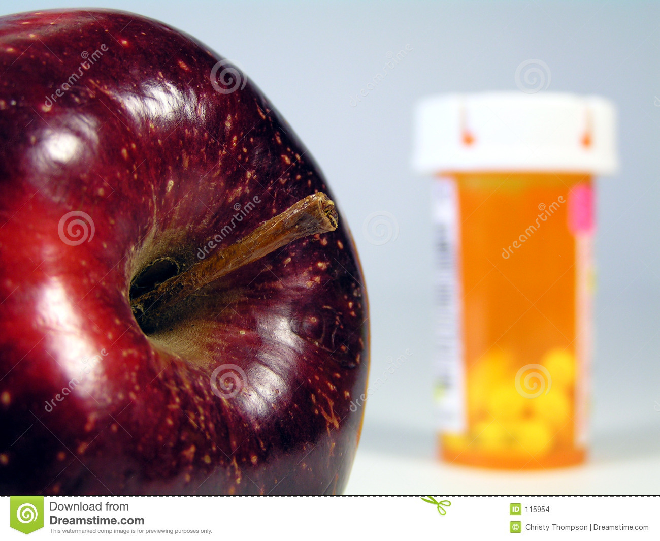 Apple and pill bottle