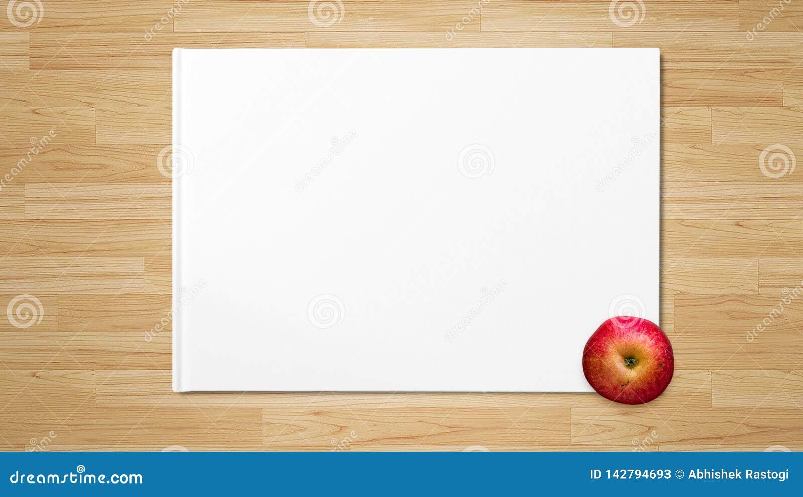 Apple rosso su Libro Bianco