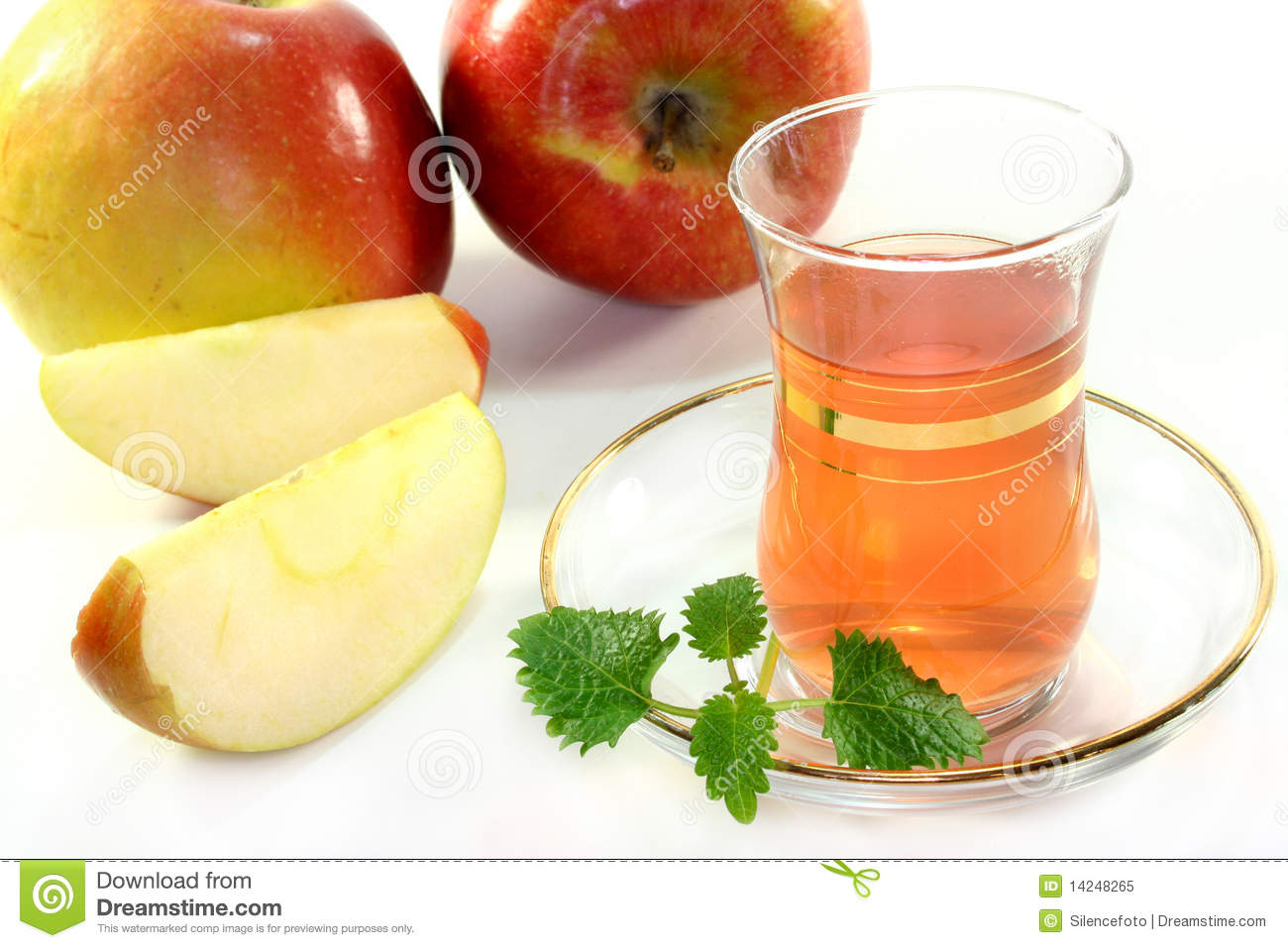 glass of apple tea with fresh apple and lemon balm.