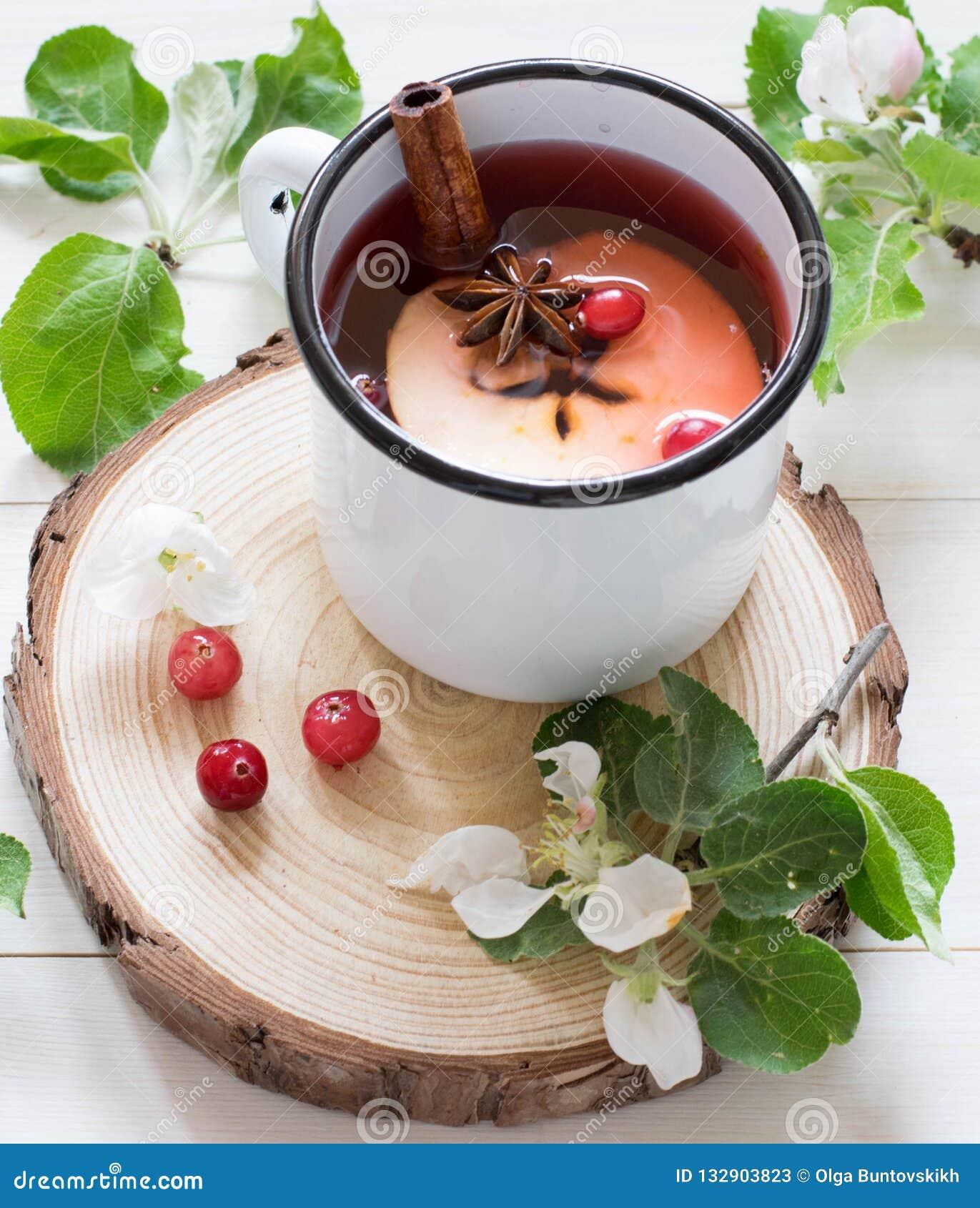 Apple tea cinnamon anis, flowers berries