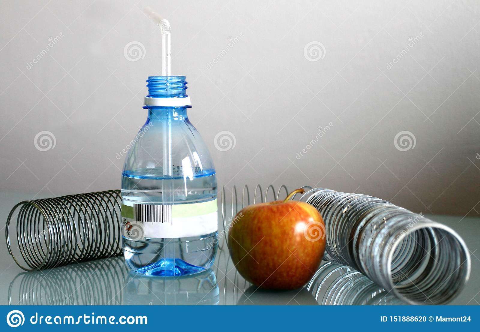 Apple water and spring on a gray background