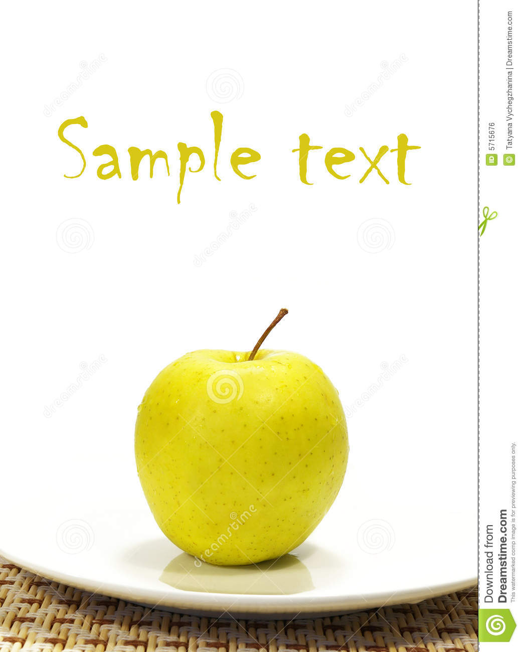 Apple on the white plate isolated