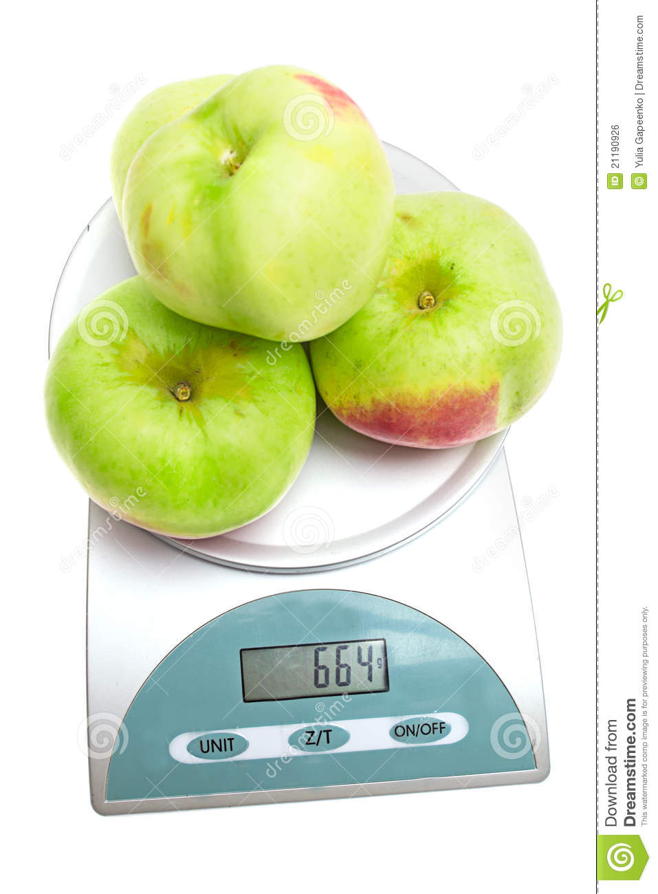 Apples on the scales isolated