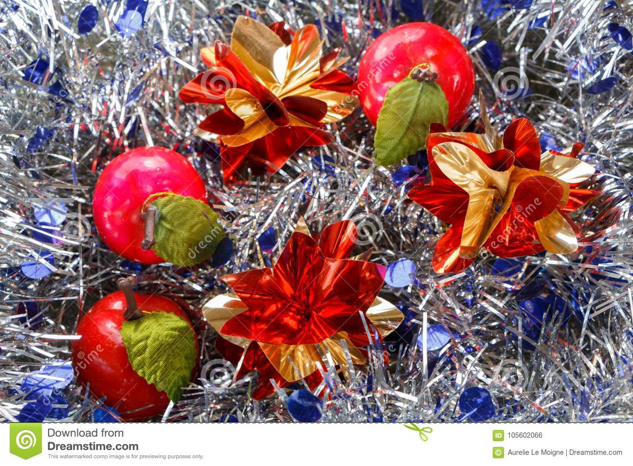 download apples and stars on a blue and silvery tinsel stock photo image of strand