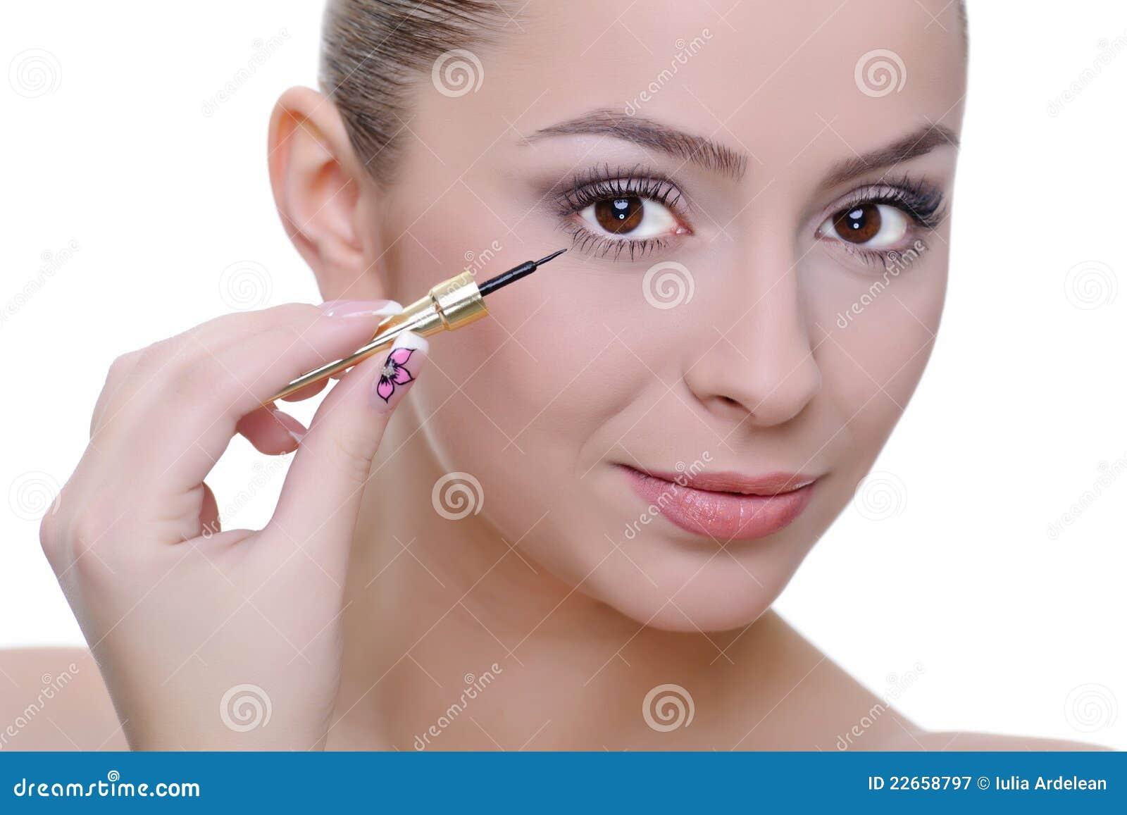 Applying eye-liner