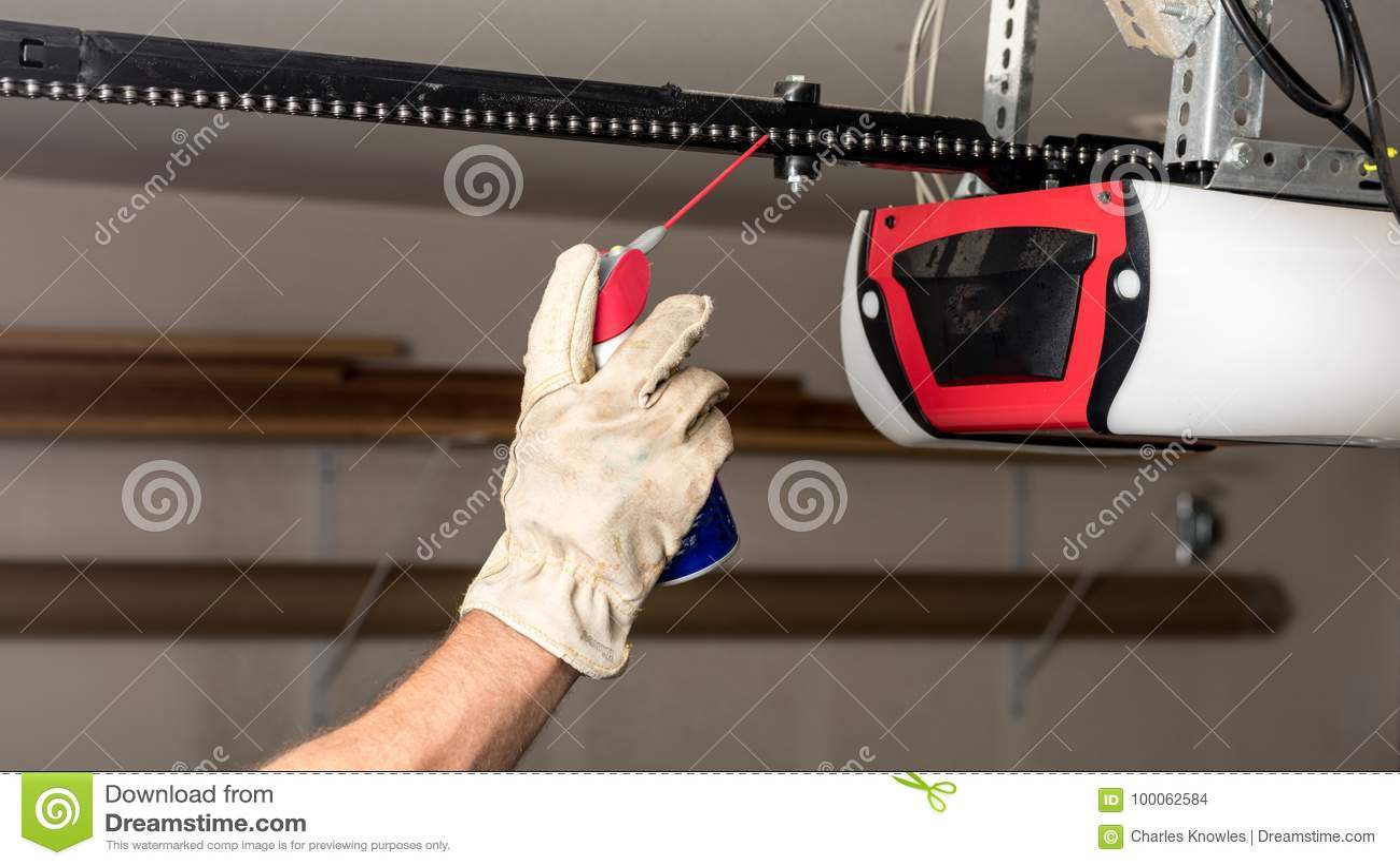 Applying Oil To A Chain Of A Garage Door Opener Stock Photo Image
