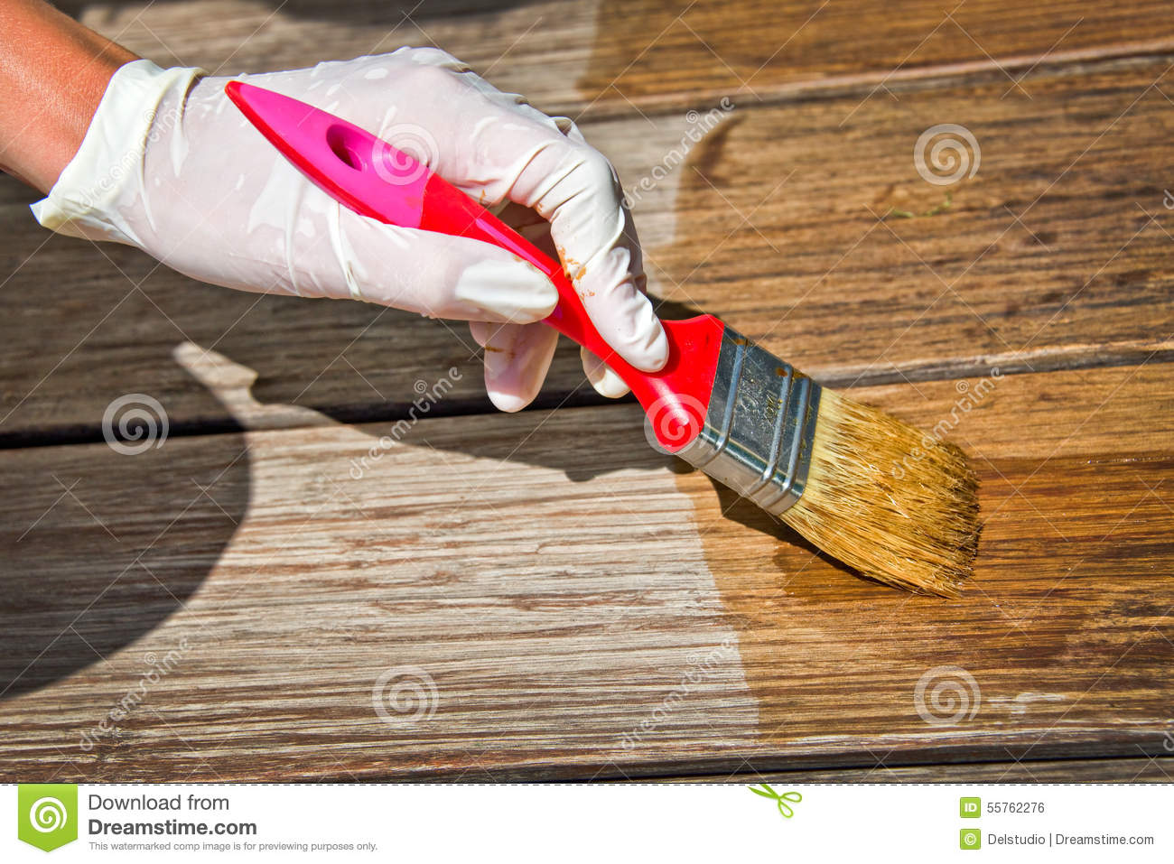 applying varnish onto a wooden surface with a brush stock image 90647791. Black Bedroom Furniture Sets. Home Design Ideas