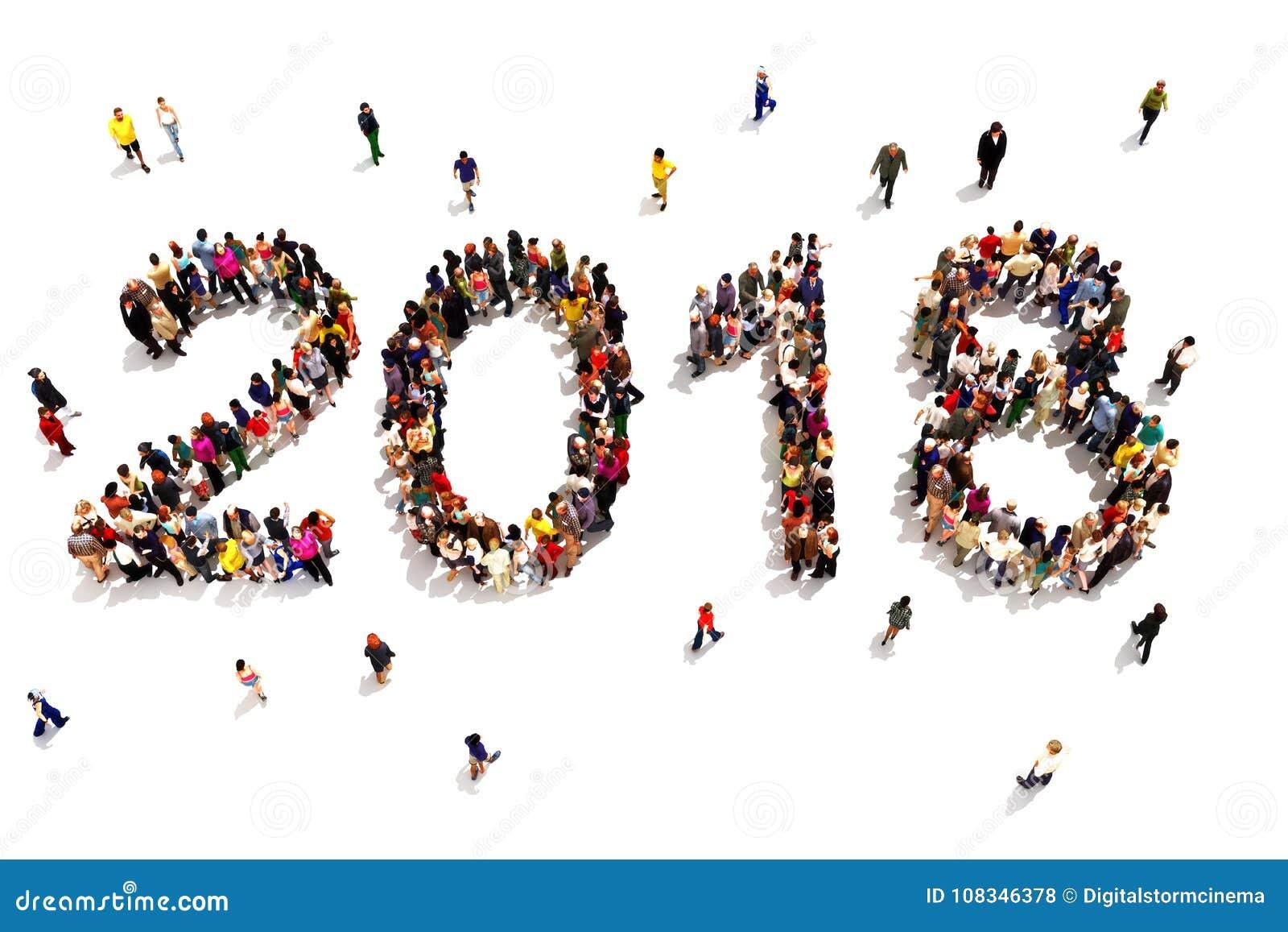 Apporter pendant la nouvelle année Grand groupe de personnes formant la forme de 2018 célébrant un concept de nouvelle année sur
