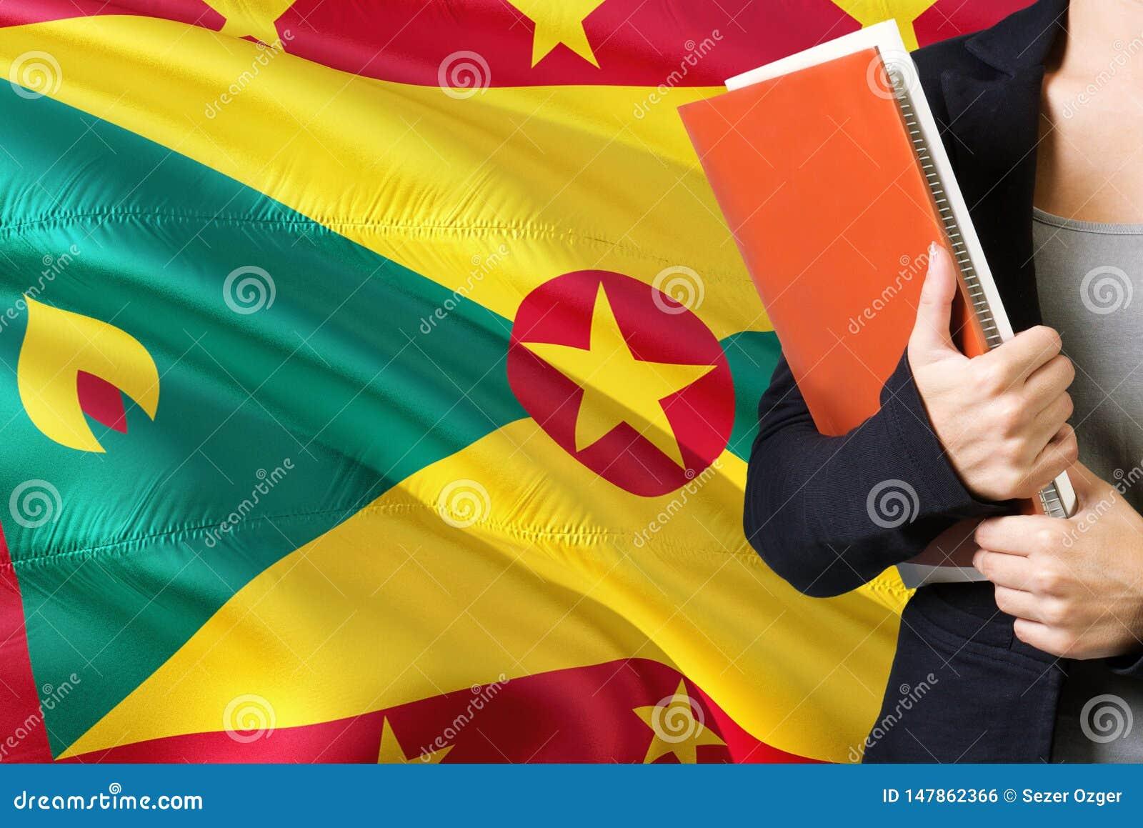 Apprendimento del concetto di Grenada di lingua Condizione della giovane donna con la bandiera della Granada nei precedenti Inseg