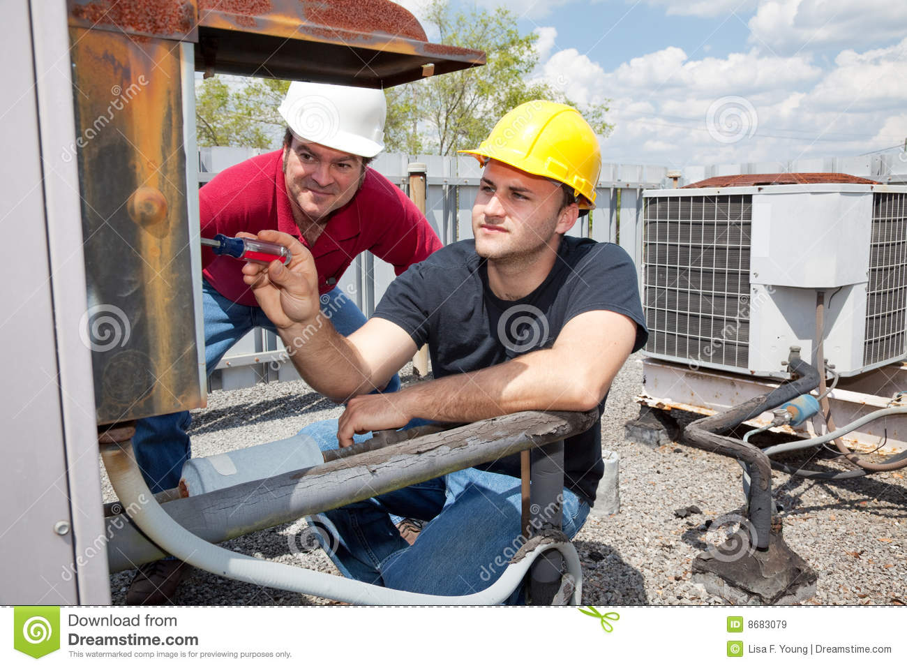 Apprentice Air Conditioning Repairman Royalty Free Stock