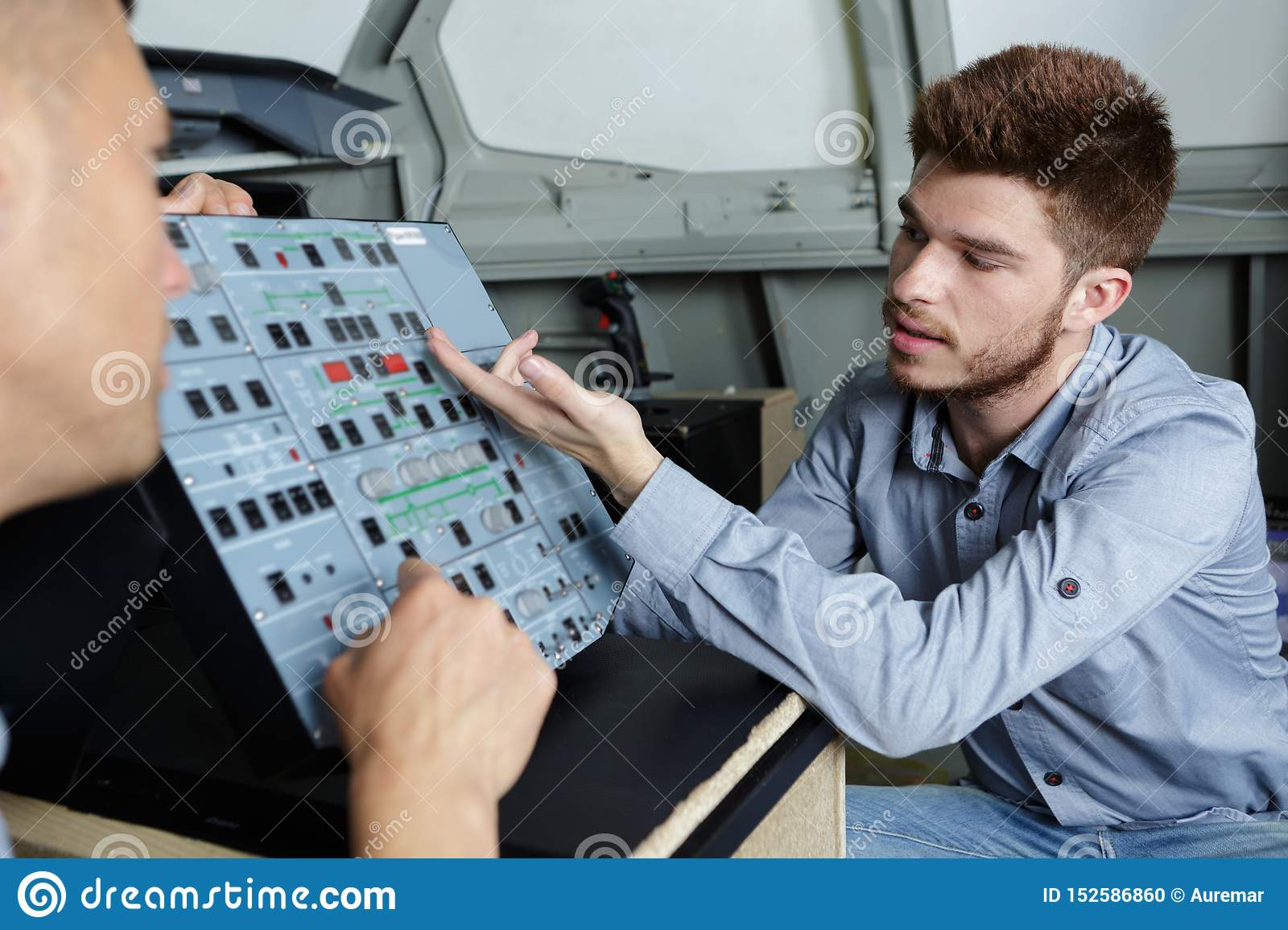 Apprentice being taught controls machine