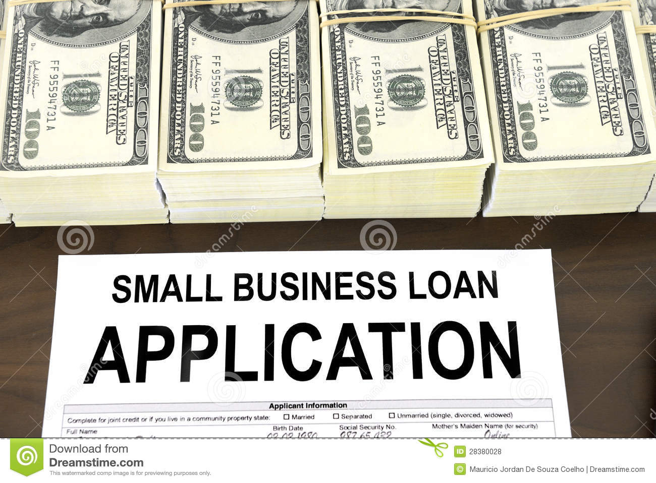 Approved small business loan application form and money stock photo approved small business loan application form and dollar bills cheaphphosting Image collections