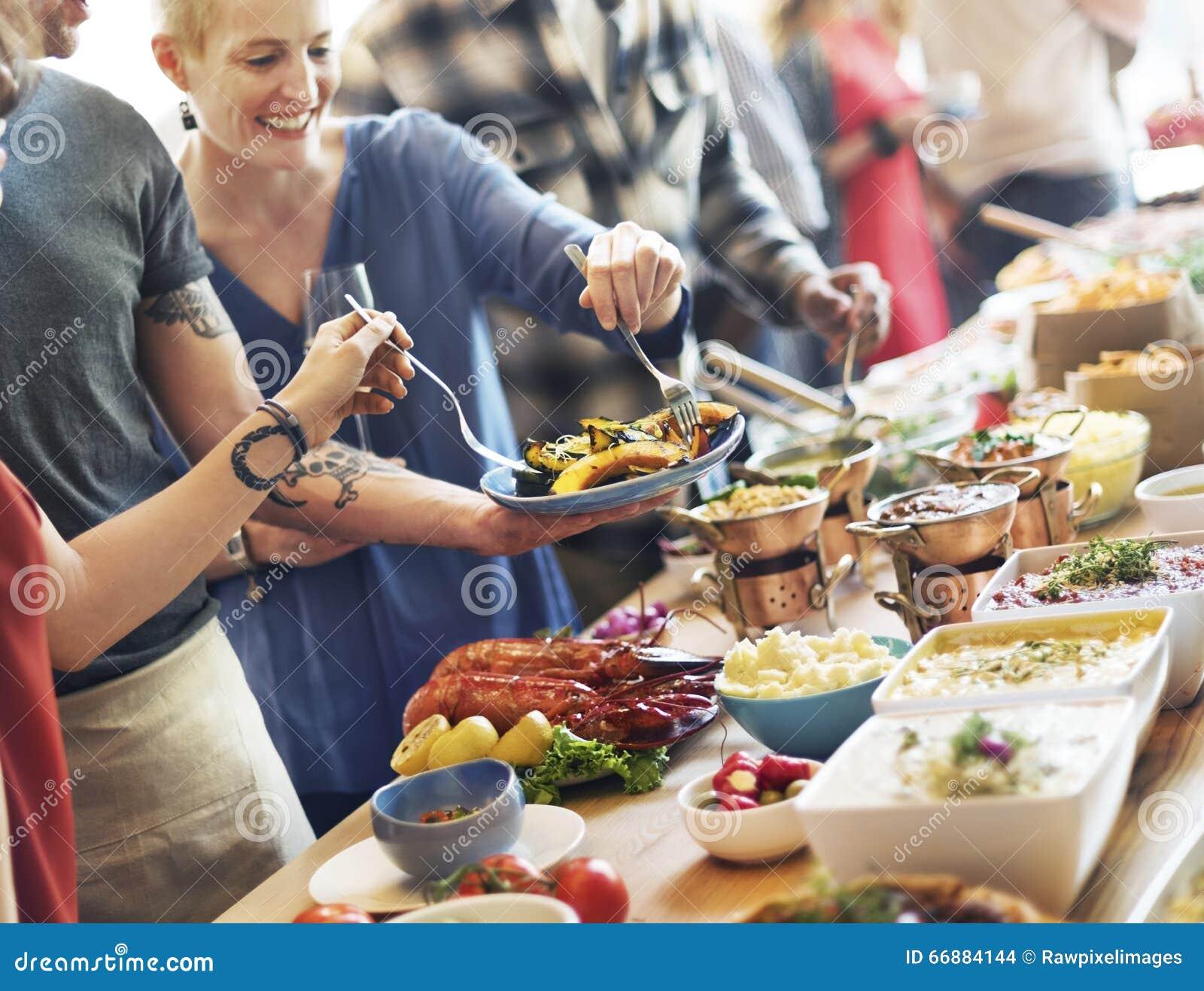 Approvvigionamento del buffet dell alimento che pranza mangiando partito che divide concetto