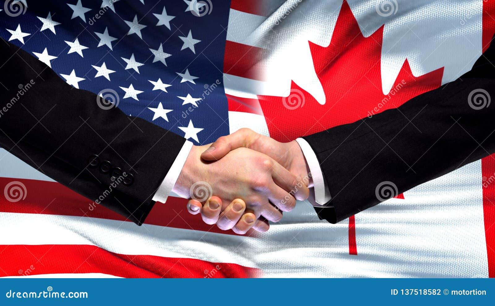 Apretón de manos de Estados Unidos y de Canadá, amistad internacional, fondo de la bandera