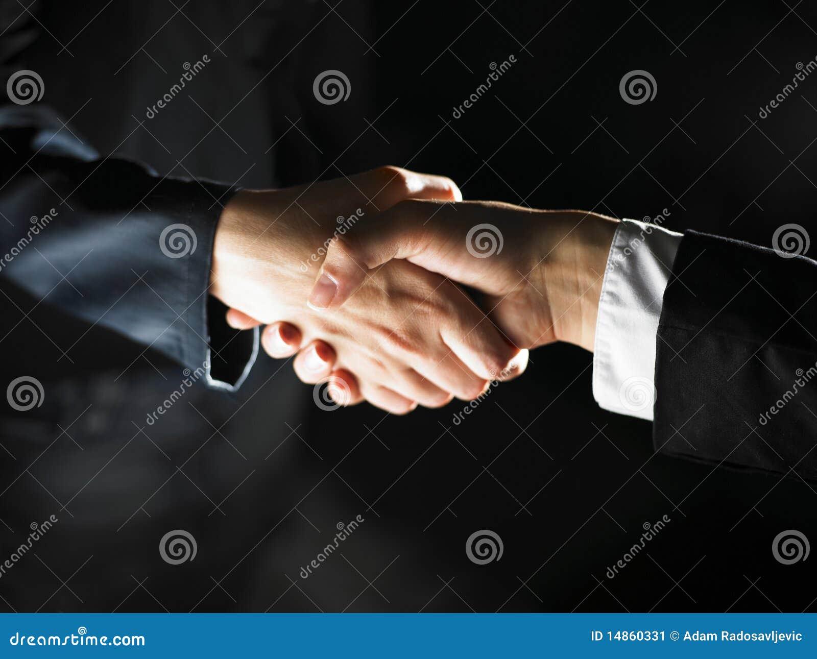 Apretón de manos y luz del apretón de manos