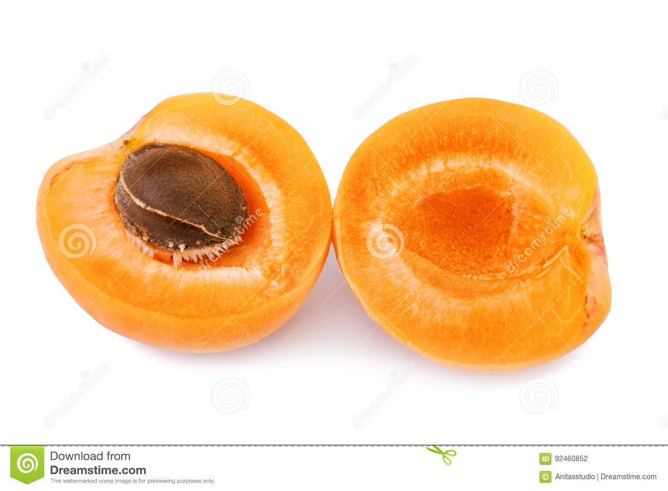 Apricot fruit half. Two halves of apricot isolated on white