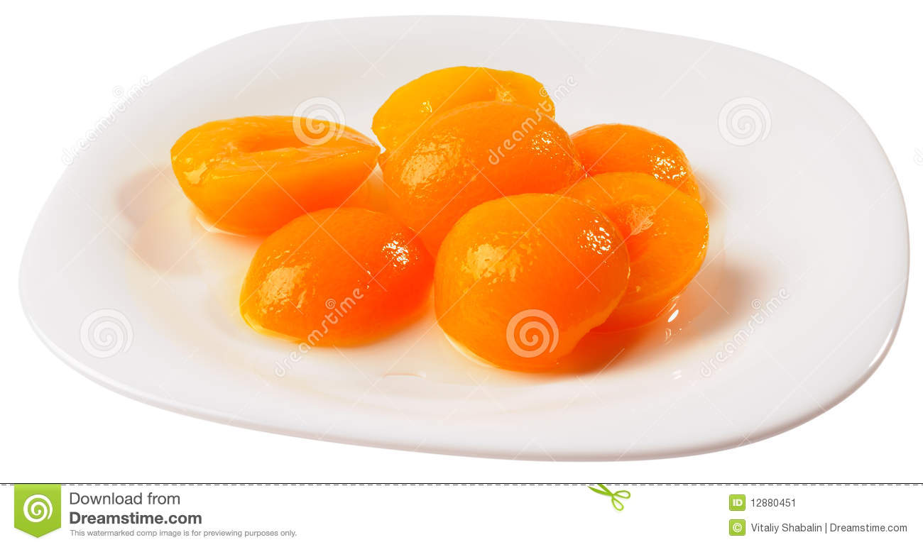 Apricot halves on plate isolated