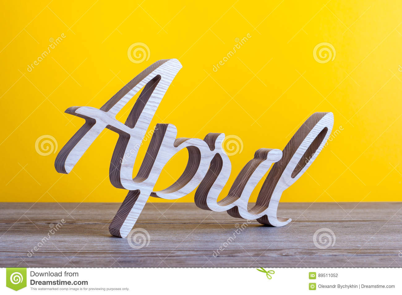 April Carved Text Of Wooden At Light Yellow Background Second
