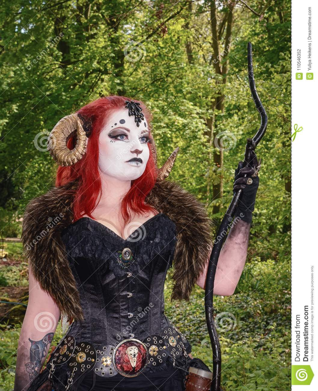 Beautiful Red Haired Woman Wearing Ram Horns At The Elf Fantasy