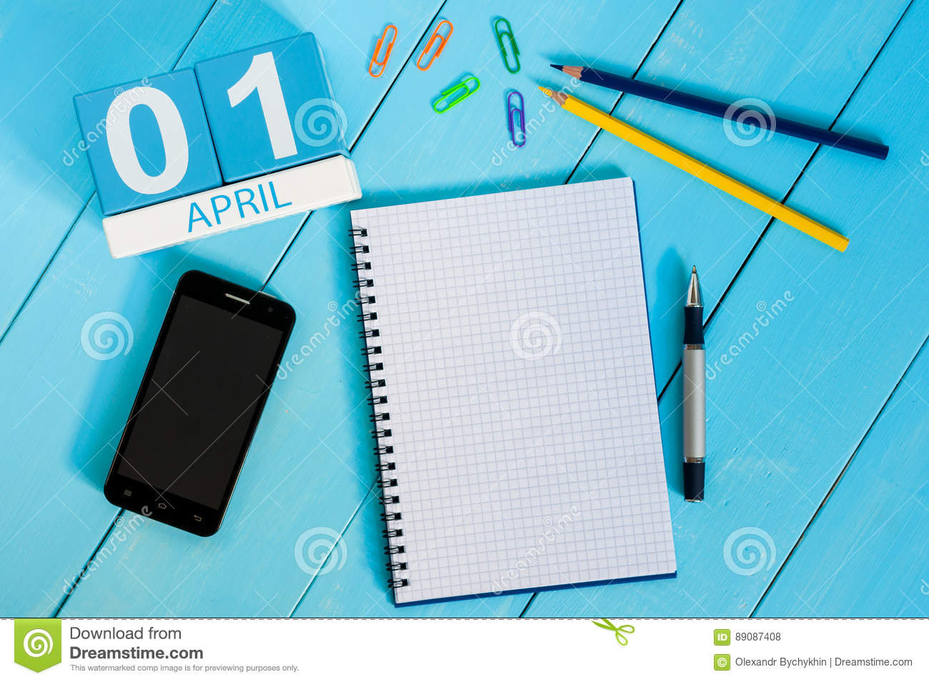 April 1st. Image of april 1 wooden color calendar on blue background. Empty space for text. All Fool`s Day