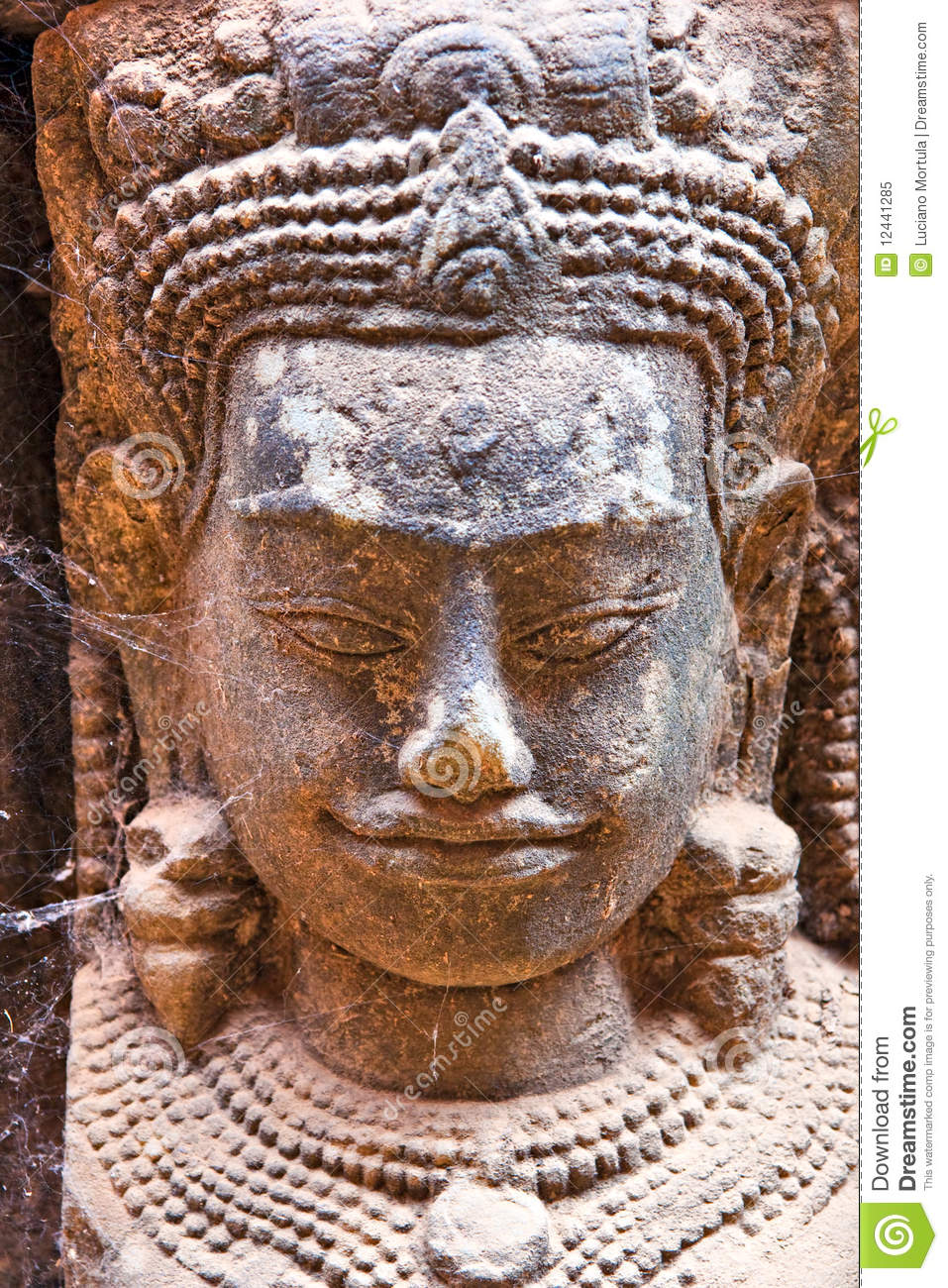 Apsara face carved on stone angkor wat cambodia stock