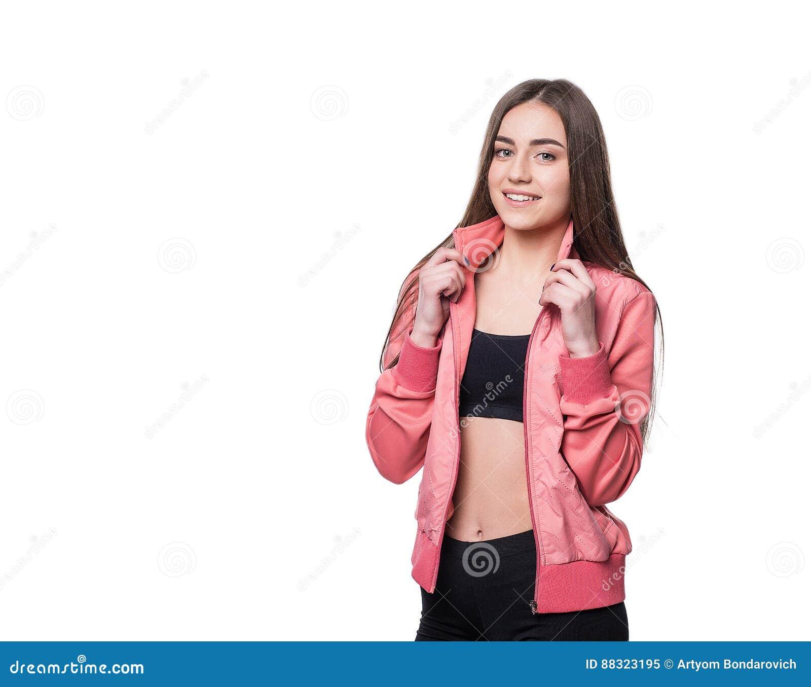 Aptidão-menina de sorriso nova no estilo do esporte isolada no fundo branco Conceito saudável do estilo de vida