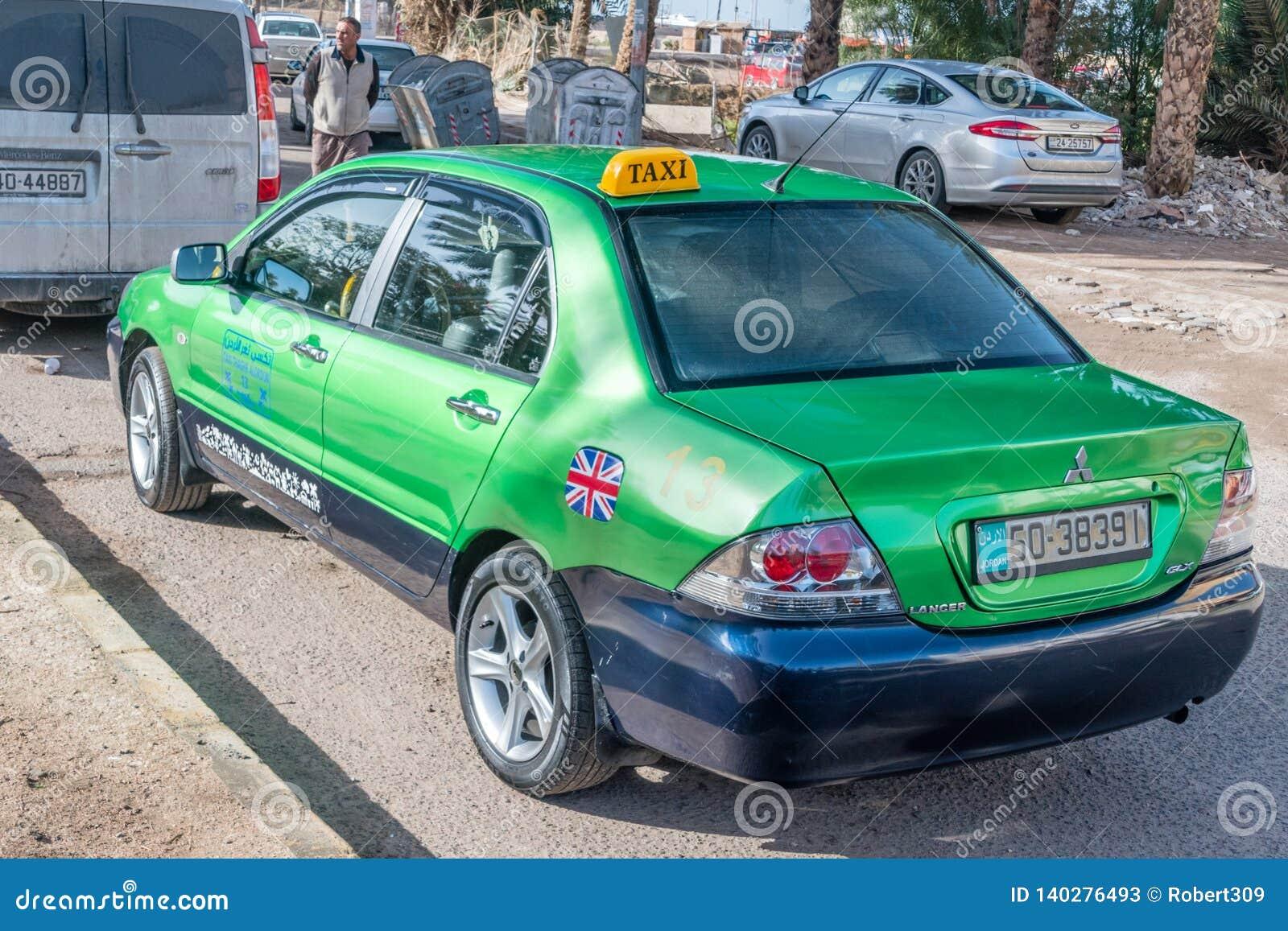 Green Mitsubishi Lancer GLX Taxi Car In Aqaba City Editorial