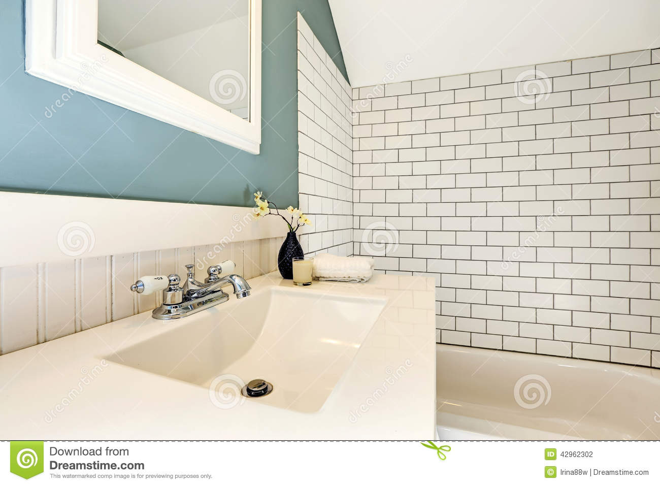 Aqua Bathroom With White Tile Wall Trim Stock Photo