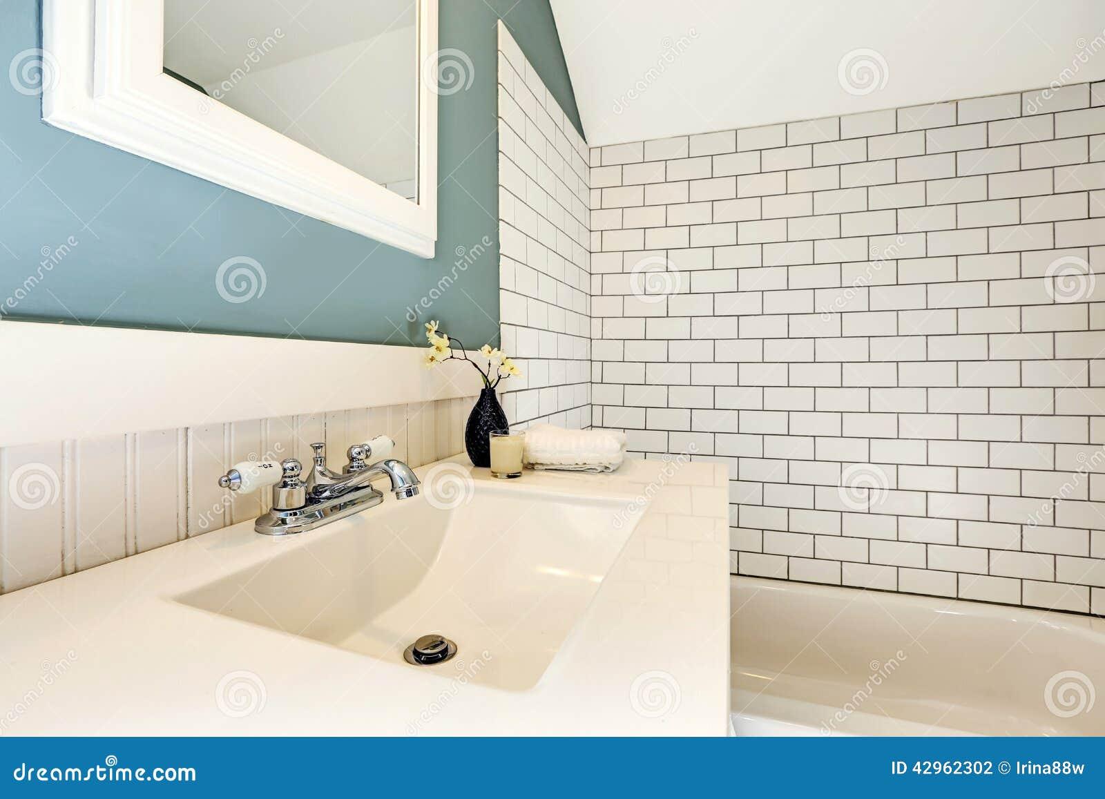 Aqua Bathroom With White Tile Wall Trim Stock Photo