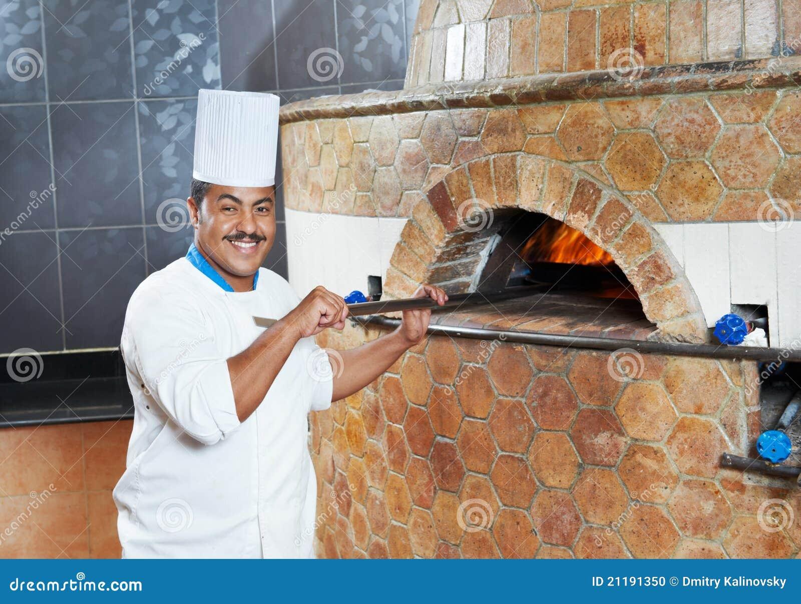 Arab baker chef making Pizza