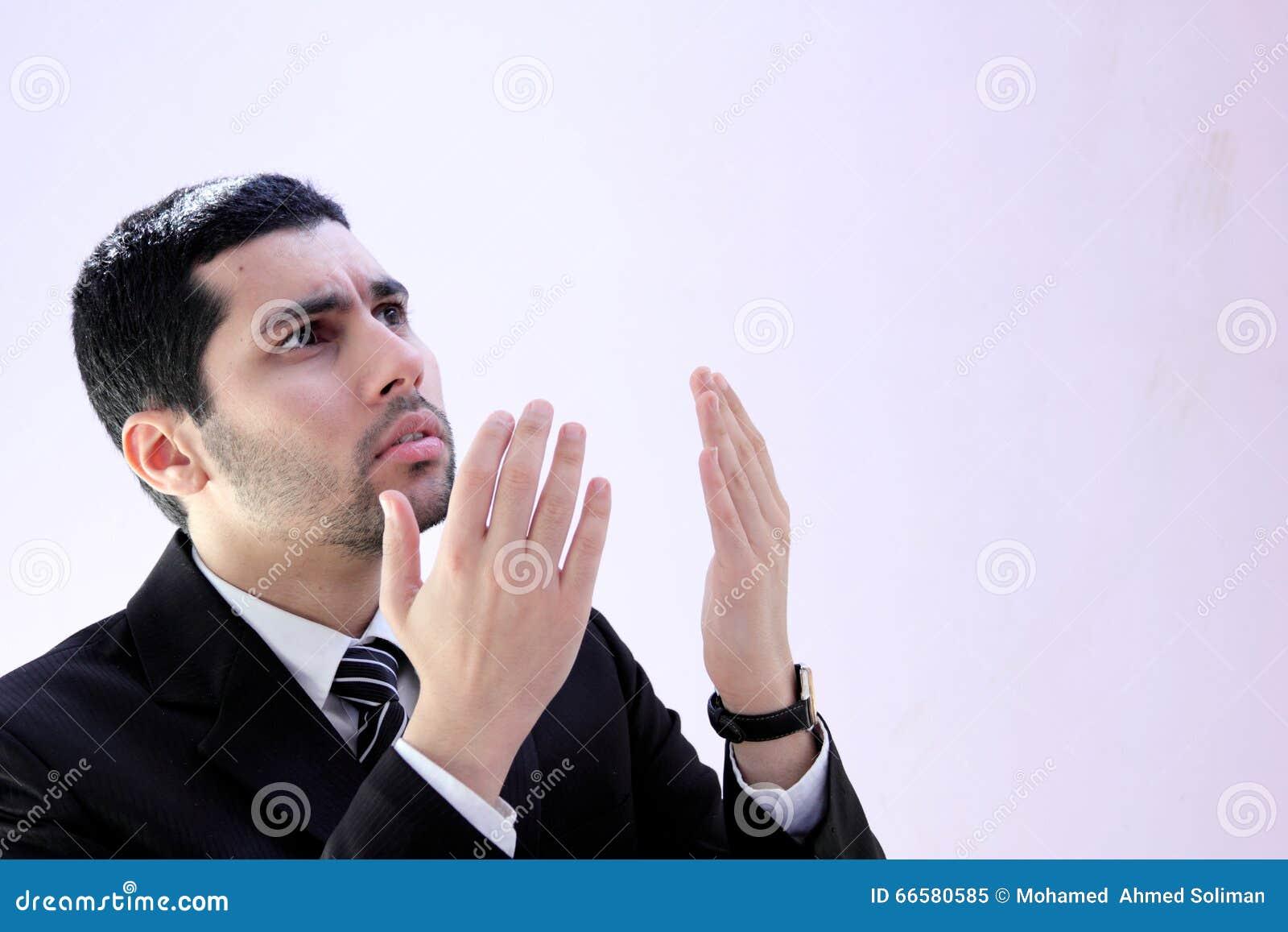 Arab business man praying for help