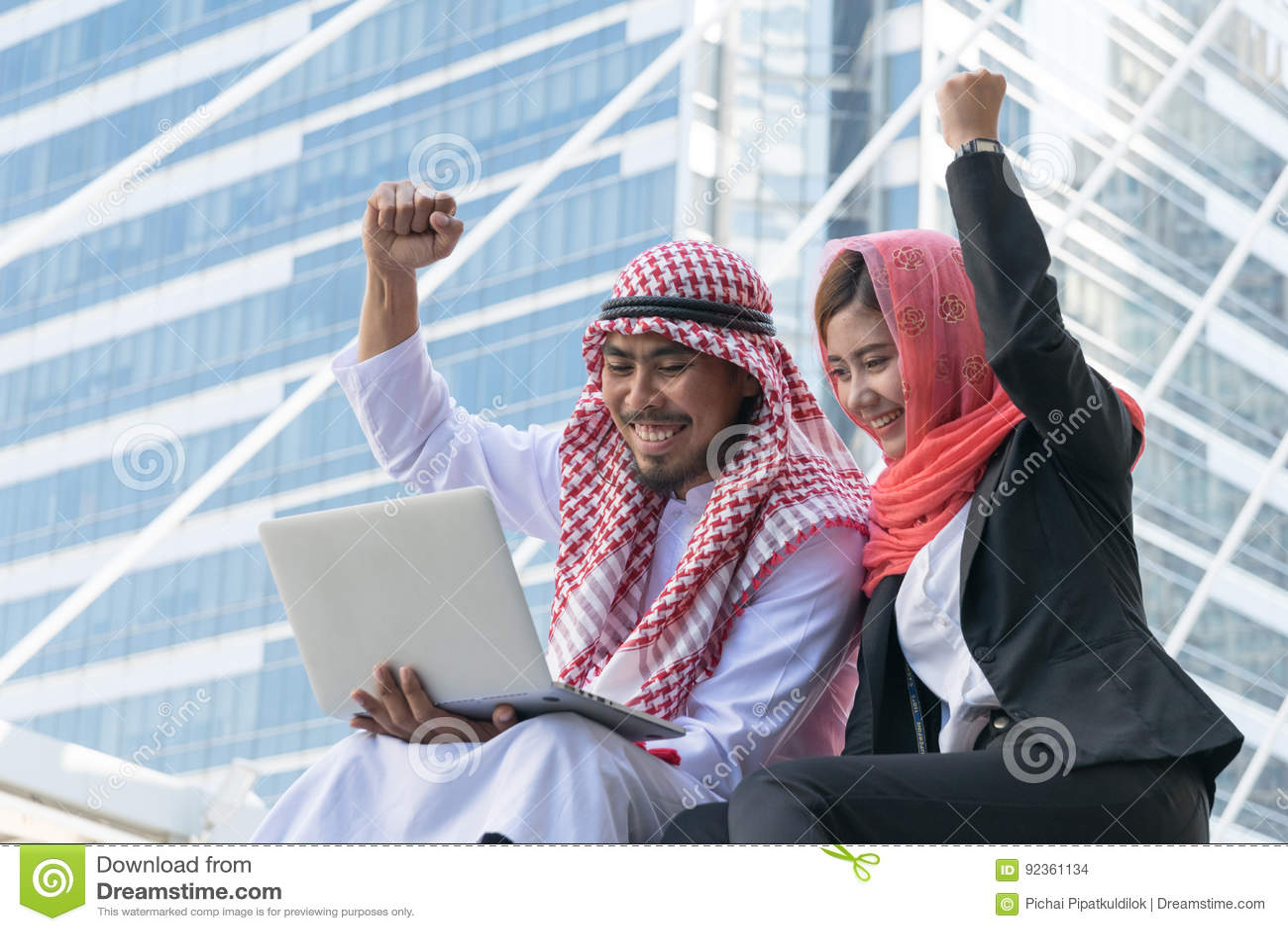 Arab Businessman and Businesswoman using computer