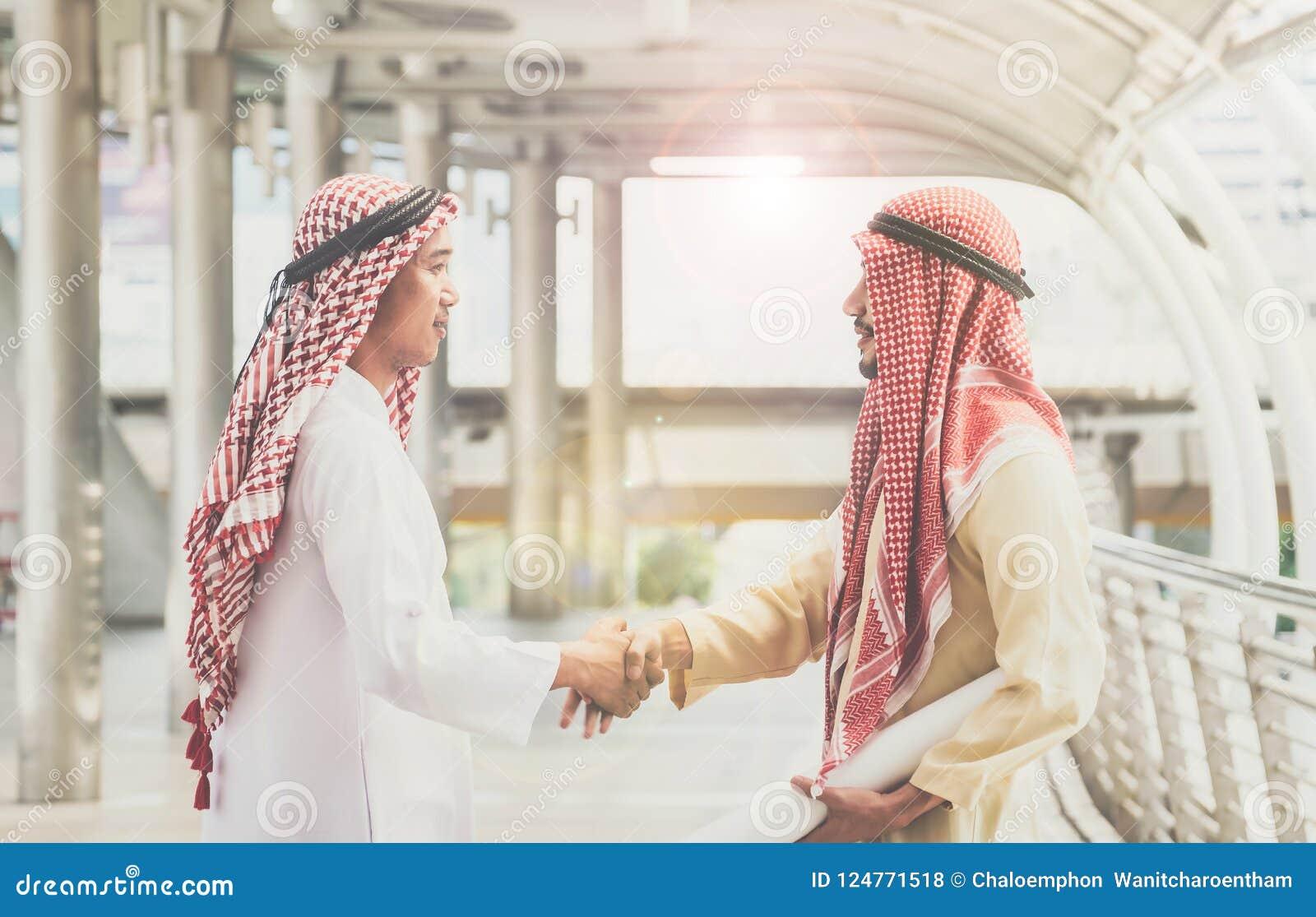 Arab businessmen shake hands and accept business deals for teamw download arab businessmen shake hands and accept business deals for teamw stock photo image of m4hsunfo