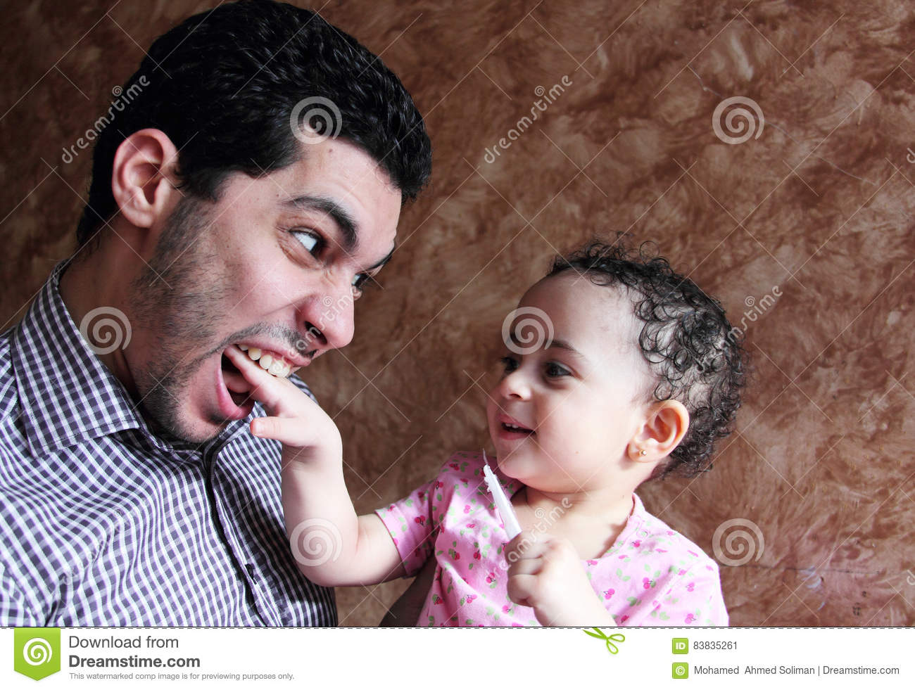 Arab egyptian baby girl playing with her father