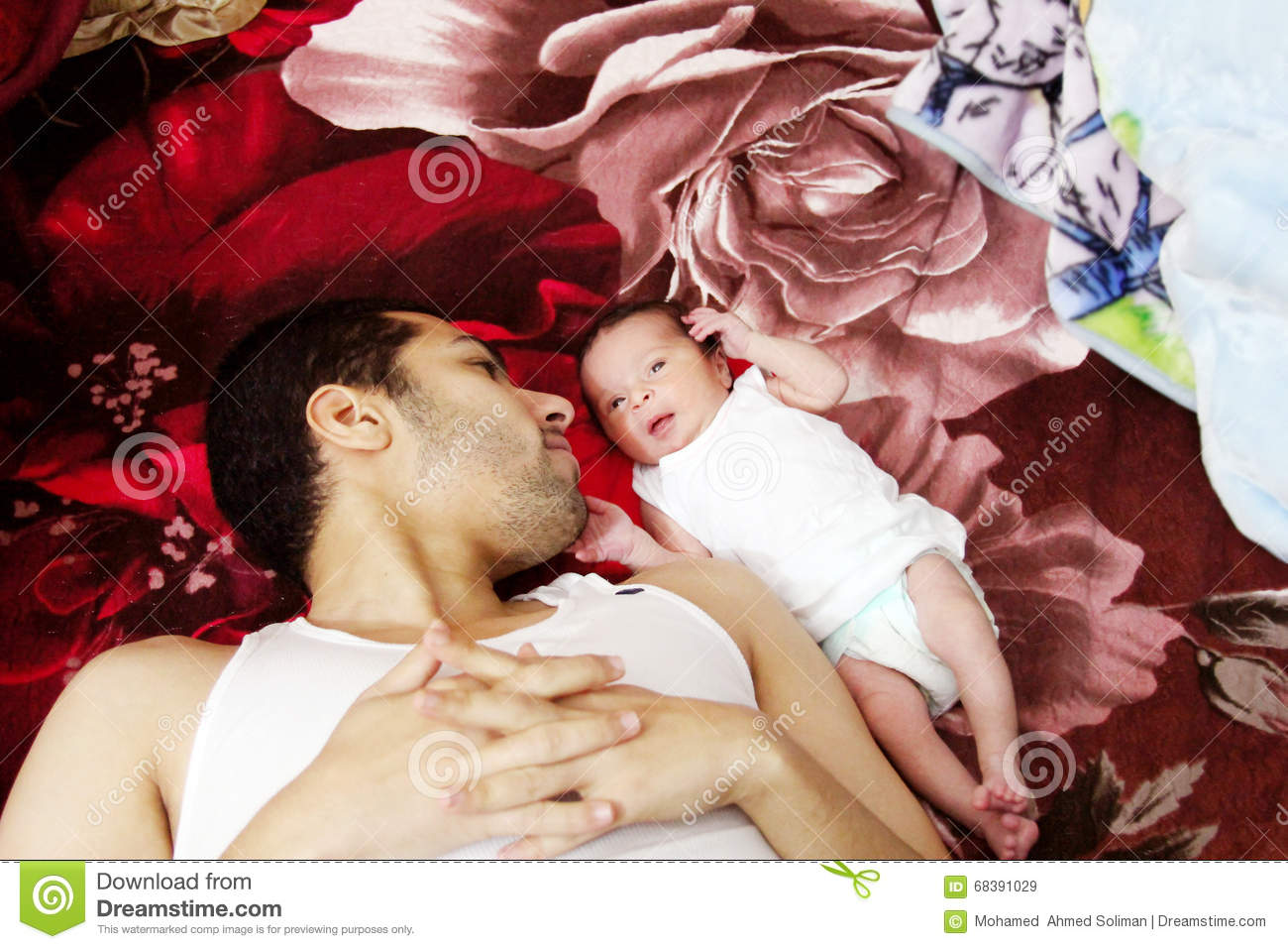 Arab egyptian man with his newborn baby girl