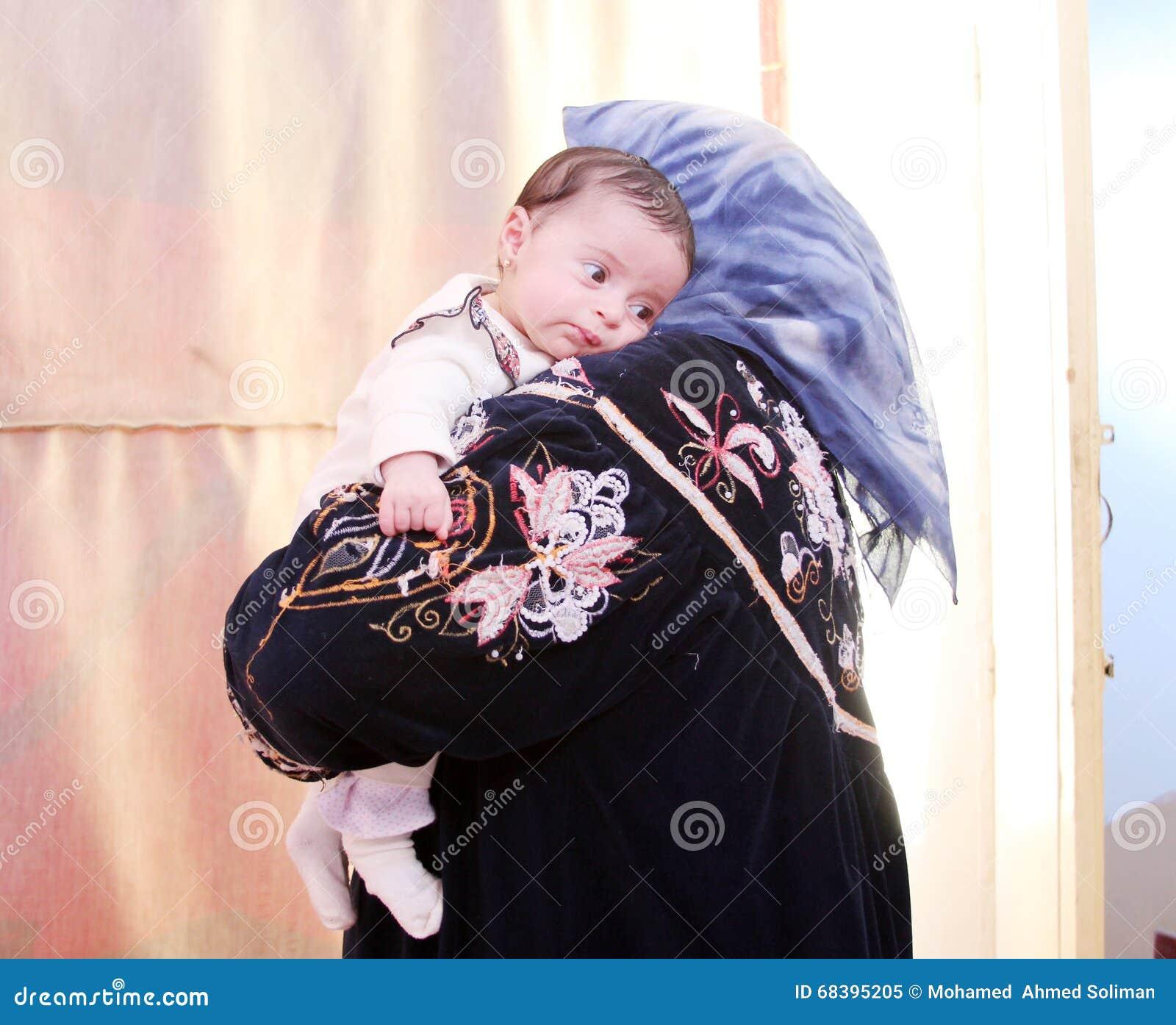 Arab egyptian newborn baby girl with grandmother