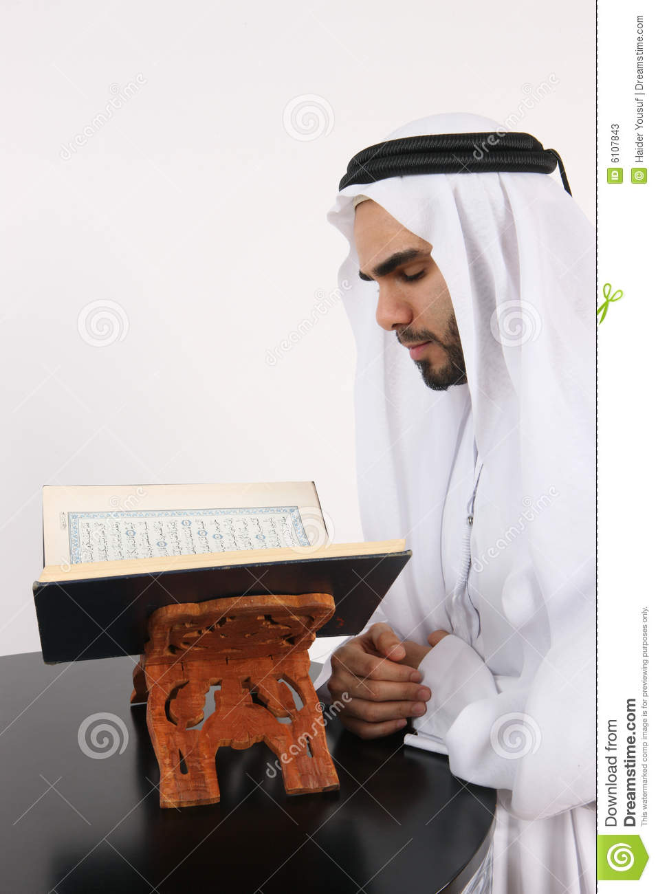 Reading The Nine Of Pentacles: Arab Man Reading The Quran Stock Image. Image Of Muslim
