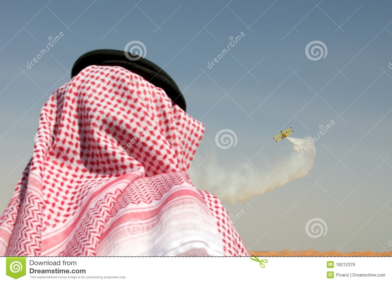 Arab man watching airshow