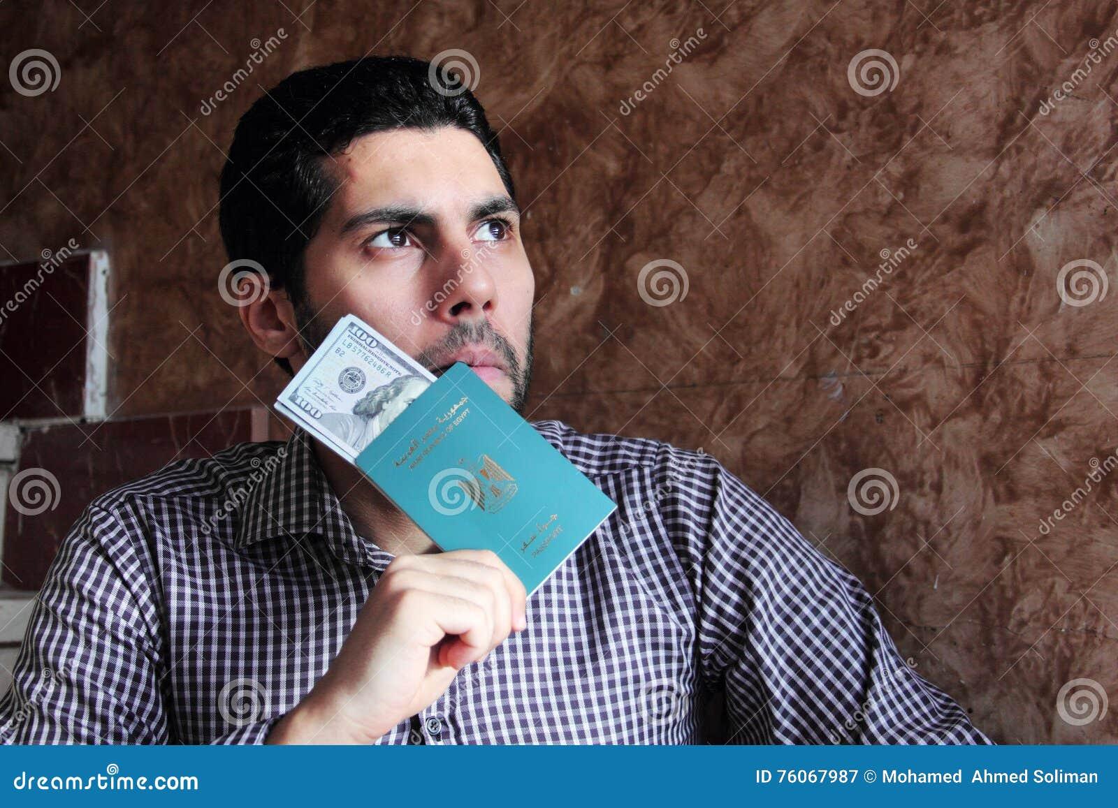 Arab muslim man with egypt passport with money