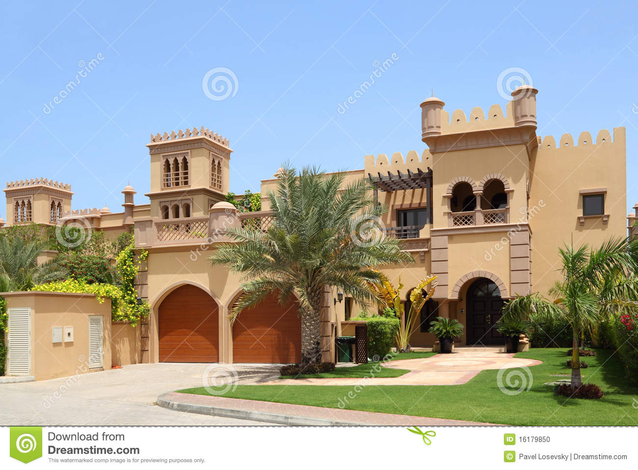 Arabian style house with two garages and archs stock photo for Arabic home design