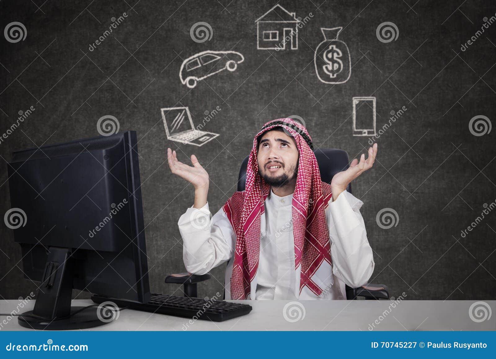 Arabic businessman thinking his dreams