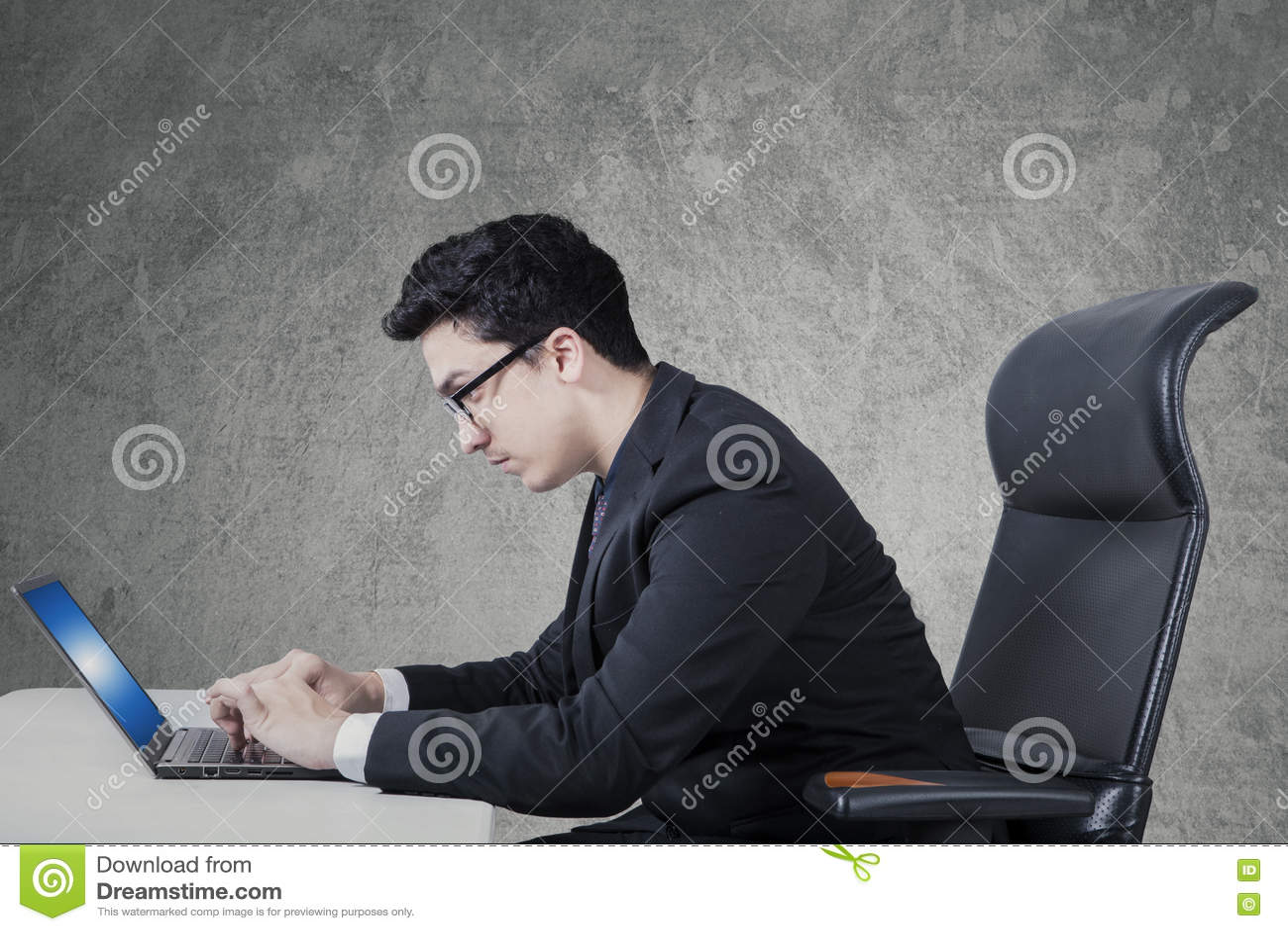 Arabic businessman uses laptop on desk