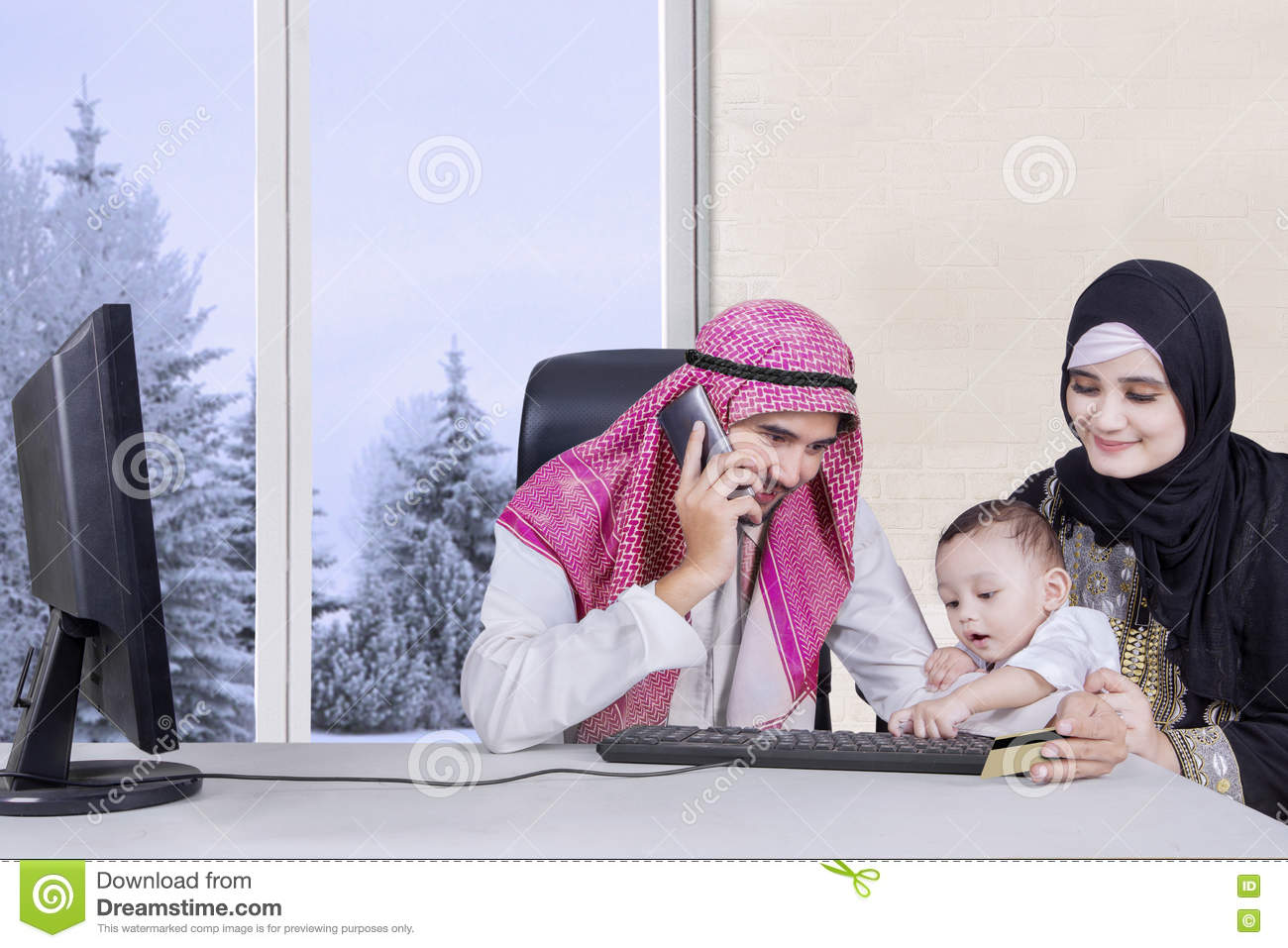 Arabic family sitting at living room